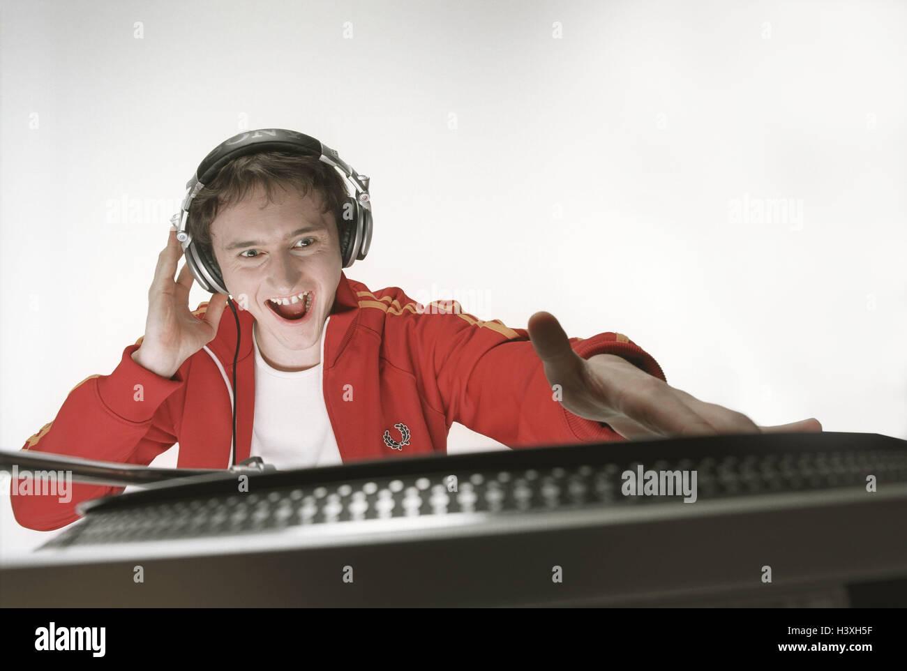 Man, young, headphones, music hears,  Plates, hangs up, portrait,   Series, 20-30 years, 25 years, single, DJ, training - Stock Image