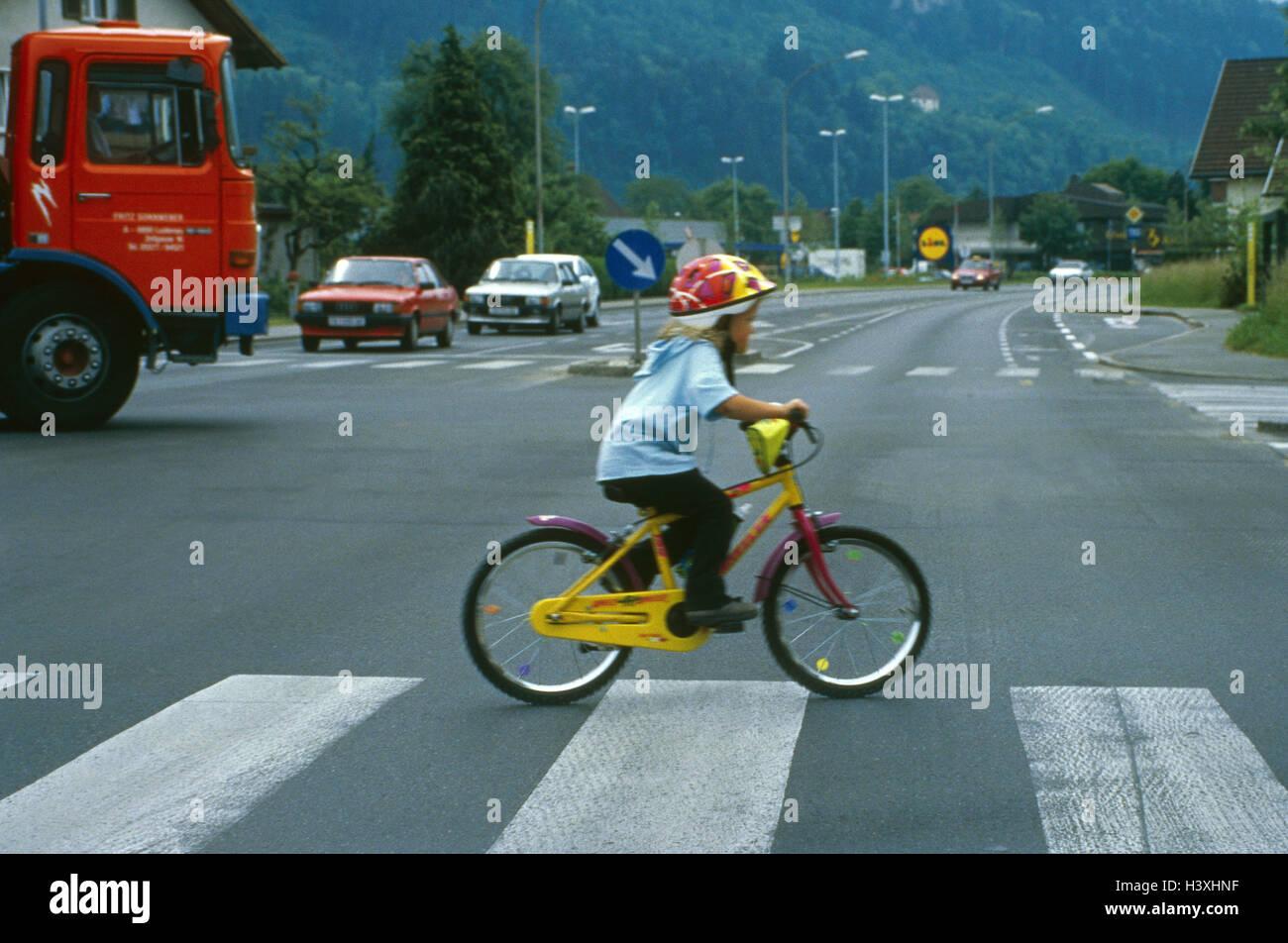 Town traffic, crosswalk, child, riding of a bike, outside, summer ...