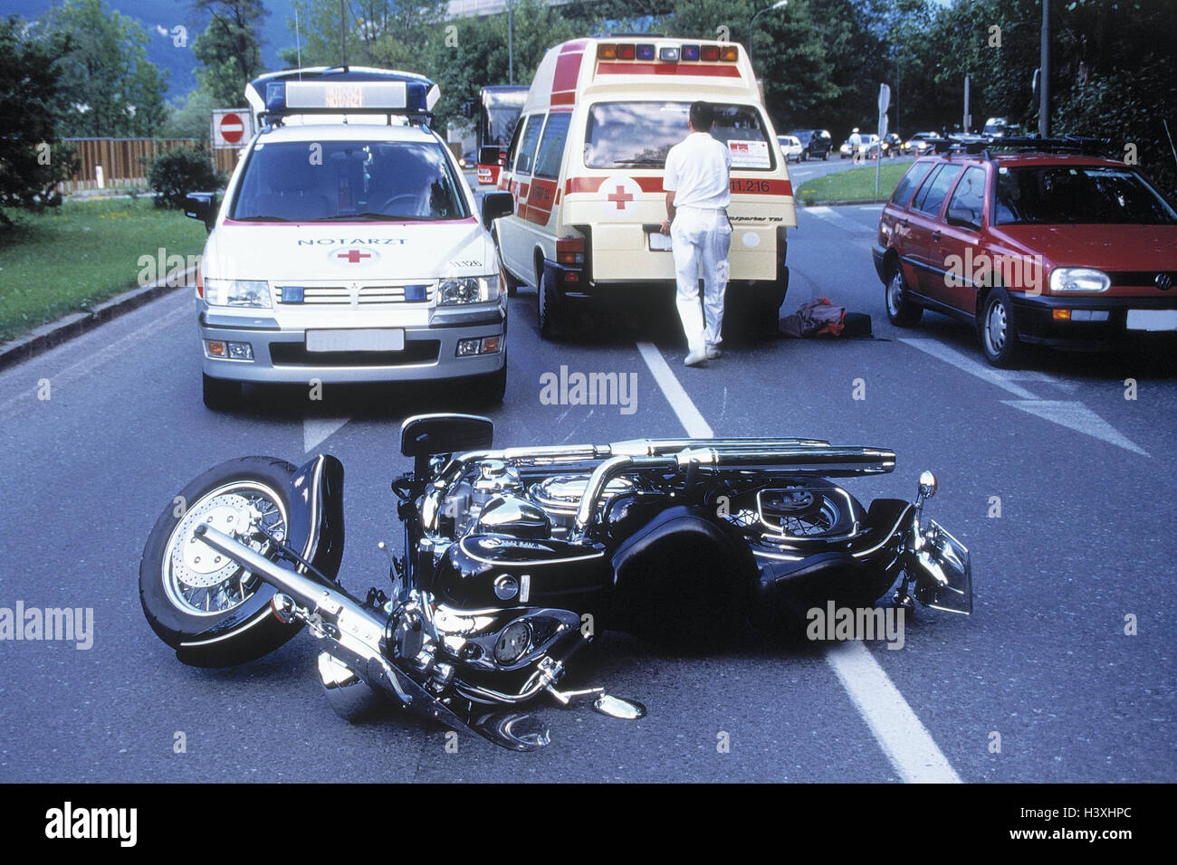 Traffic accident, street, motorcycle, emergency doctor, rescue car ...