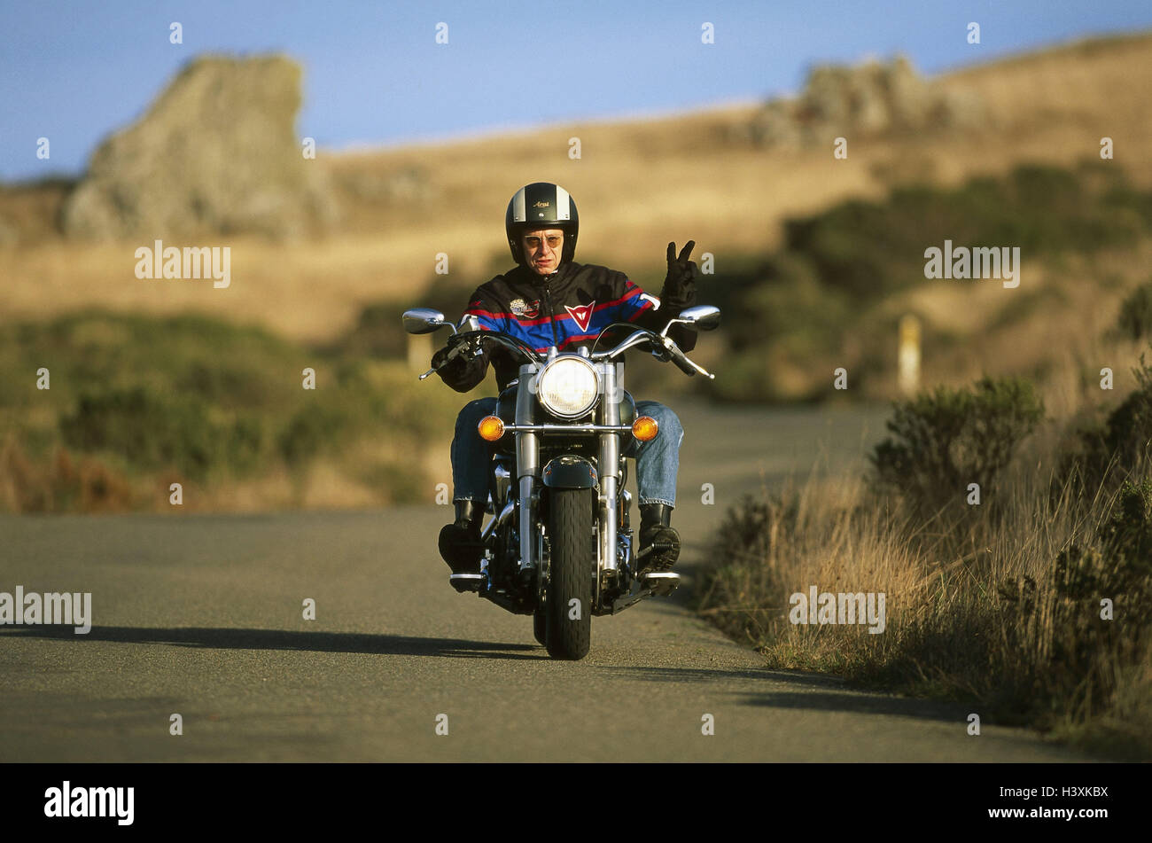Chopper driver with Yamaha on mountain road - Stock Image