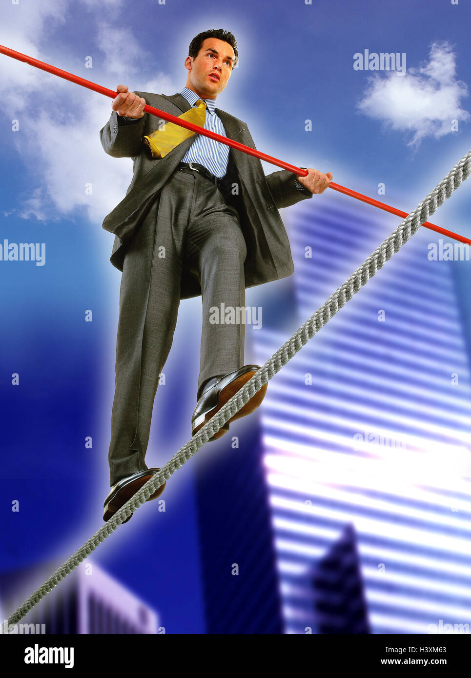 Composing, town, businessman, wire rope, balance, cloudy sky, professions, man, artiste, high rope act, balancing - Stock Image