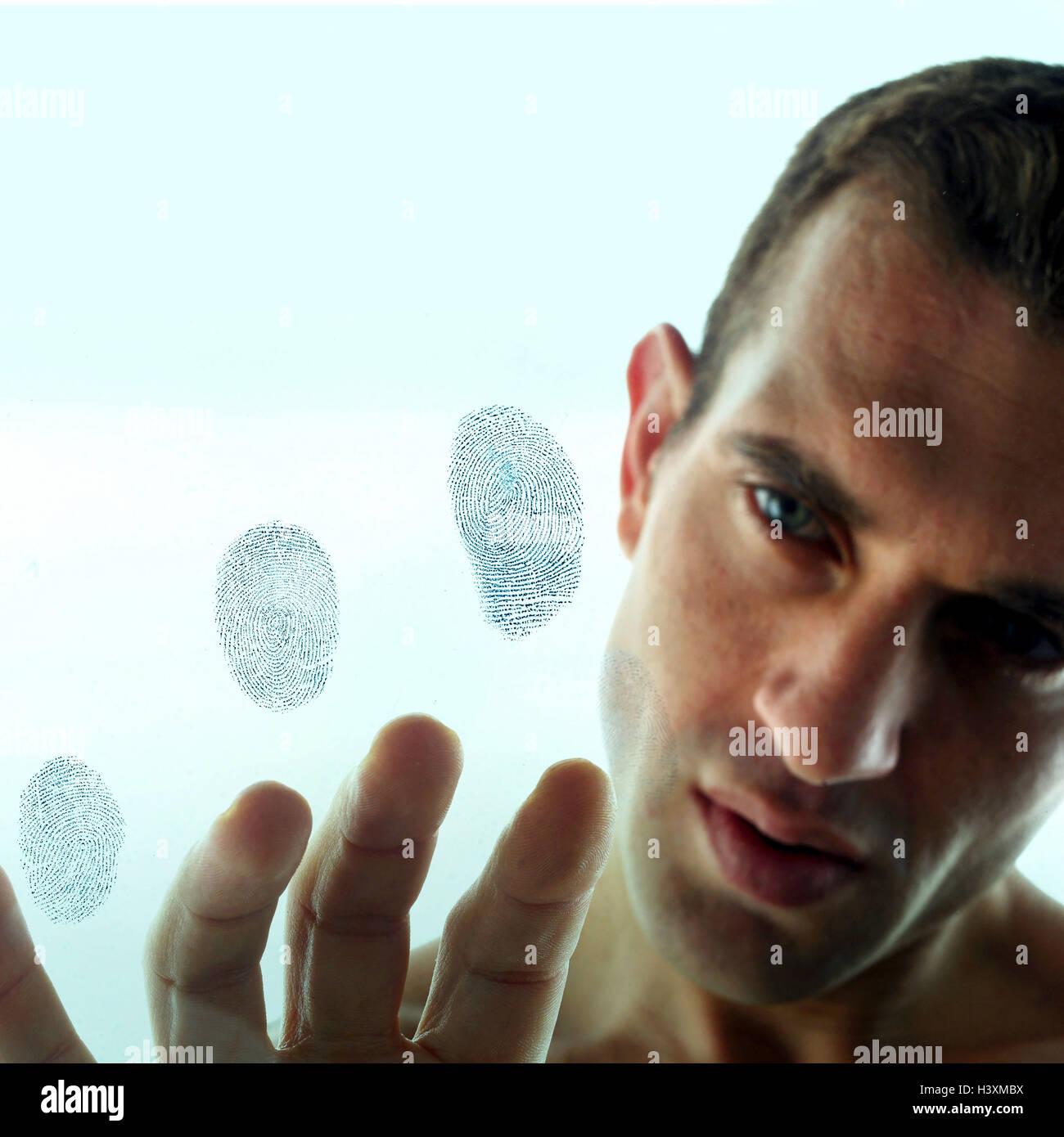 Man, seriously, portrait, windowpane, fingerprints, very close, window pane, expression, isolation, thoughtful, - Stock Image