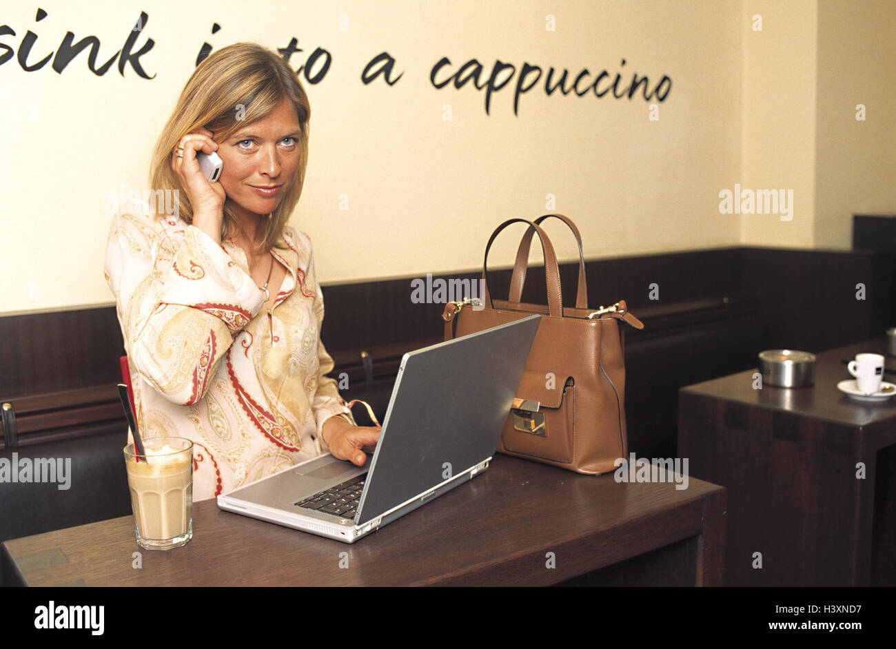 Woman, call up young, cafe, notebook computer, mobile phone, bar, standing cafe, inside, work, break, lunch break, - Stock Image
