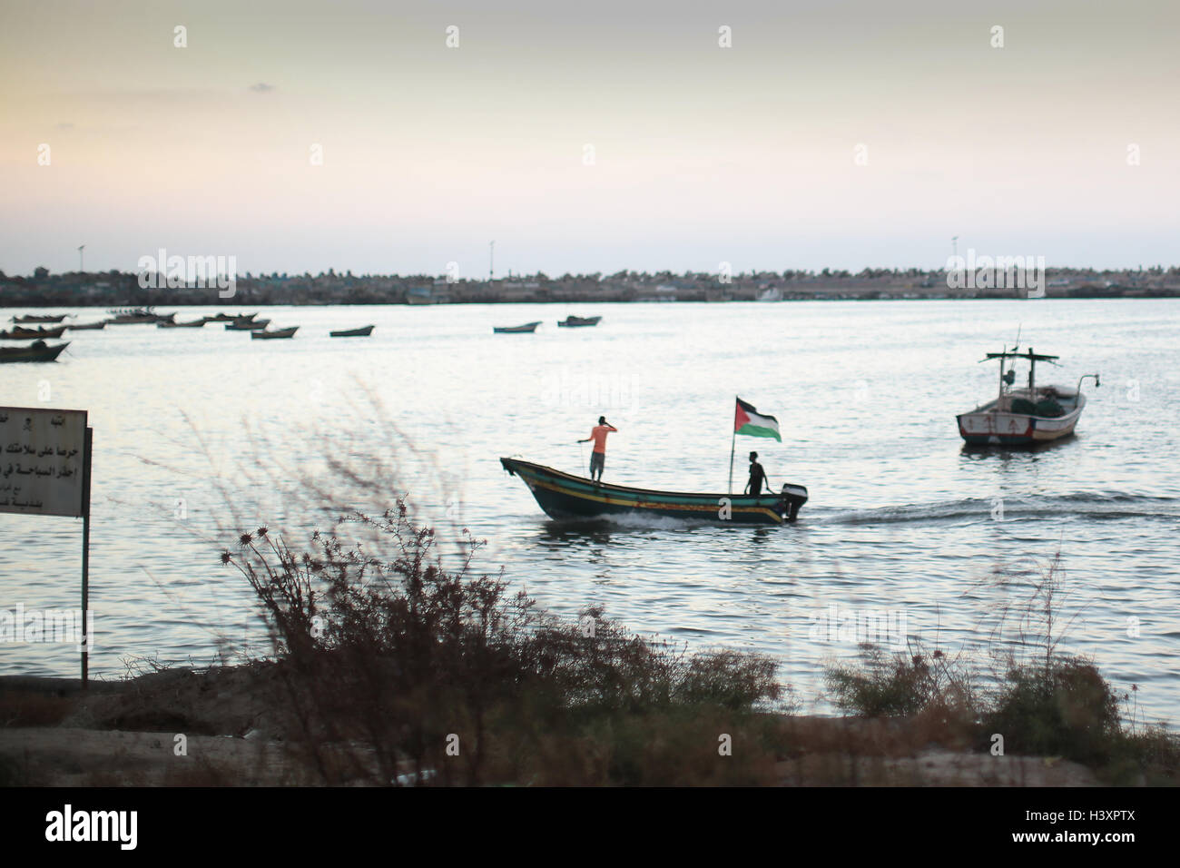 A fishing boat in Gaza flying a Palestinian flag. - Stock Image