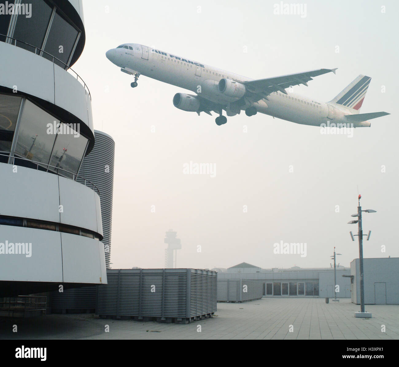 Germany, Duesseldorf, airport, tower, airplane, flying, b/w Stock Photo