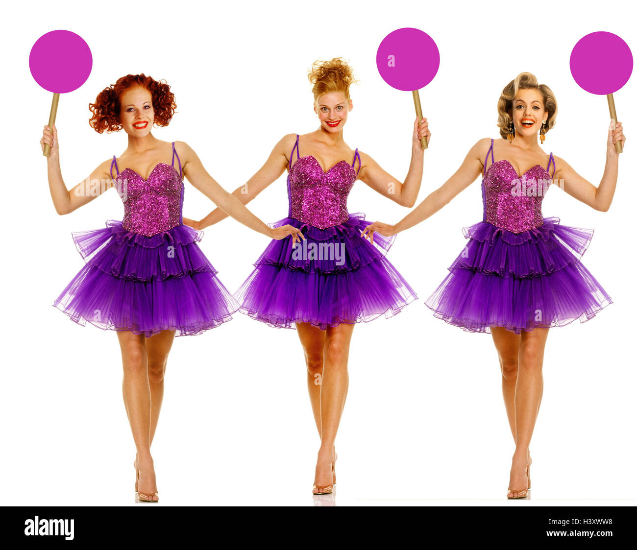 "Women, ""number girls"", tulle clothes, mauve, signs, hold up women, studio, cut out, number girl, circus, vaudeville Stock Photo"