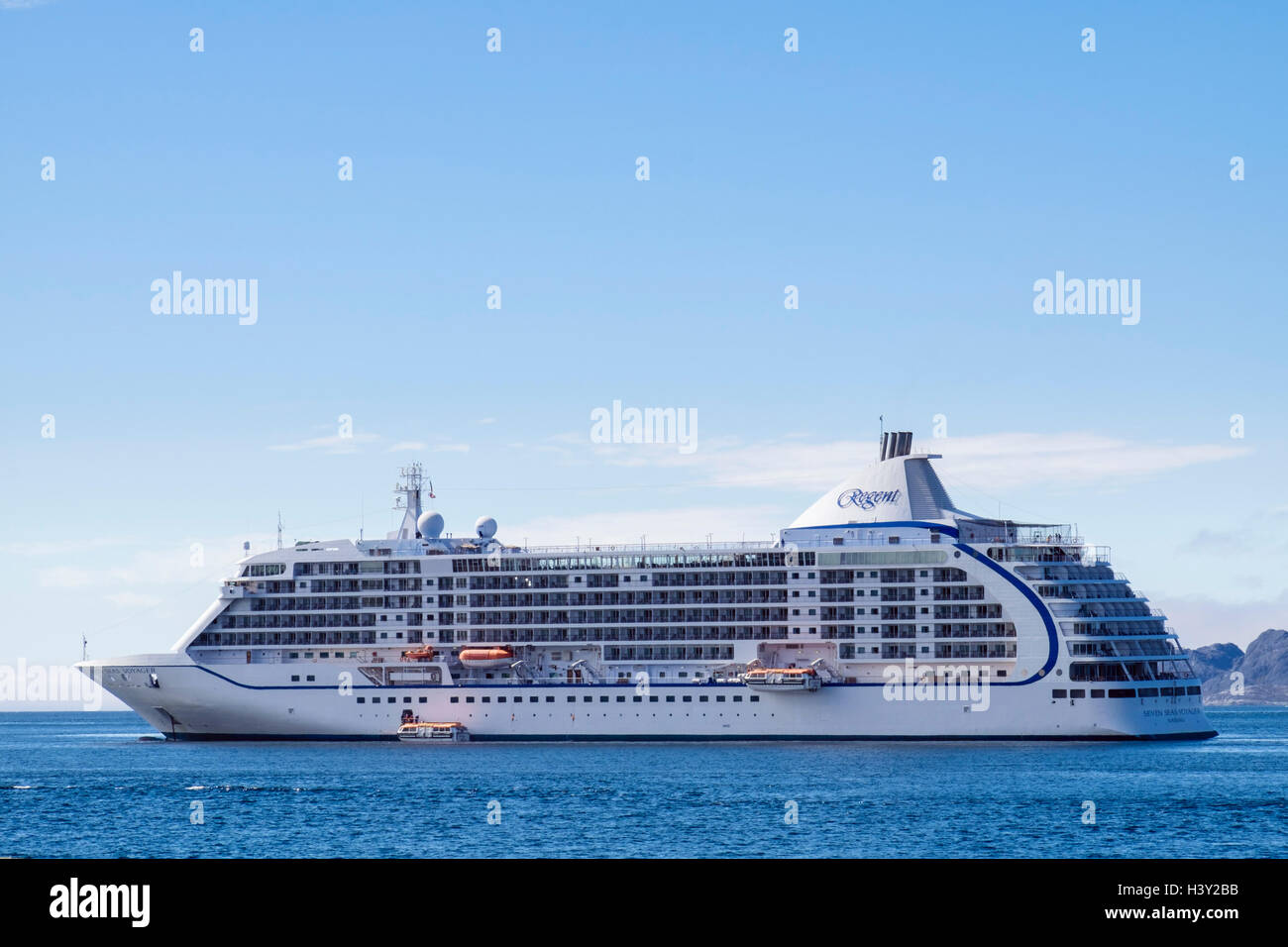 Visiting ocean cruise liner ship Seven Seas Voyager at sea anchored offshore in a fjord in summer. Nuuk (Godthab), - Stock Image