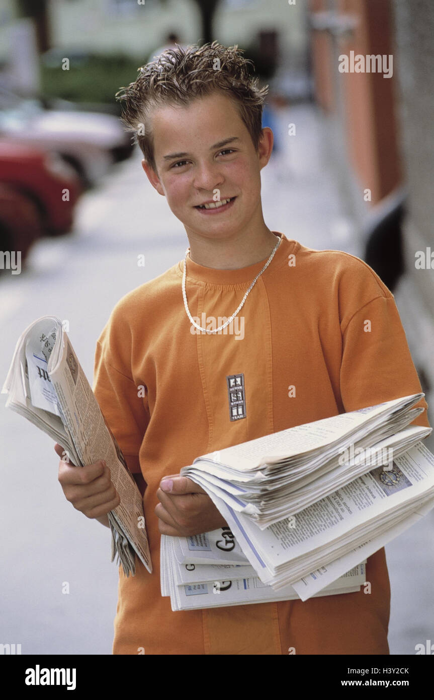 boy holidays job newspapers hold child young person teenager teenagers boy schoolboy leisure time holidays school end work job work work
