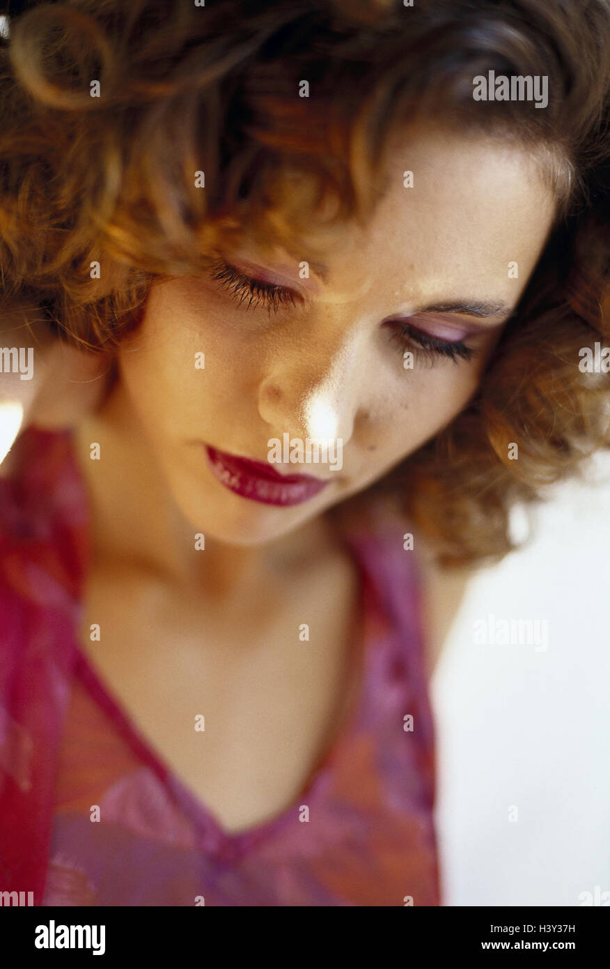 Woman, think, sadly, portrait, model released, inside, made up, thoughtful, lonely, dealts with, depresses, grief, - Stock Image