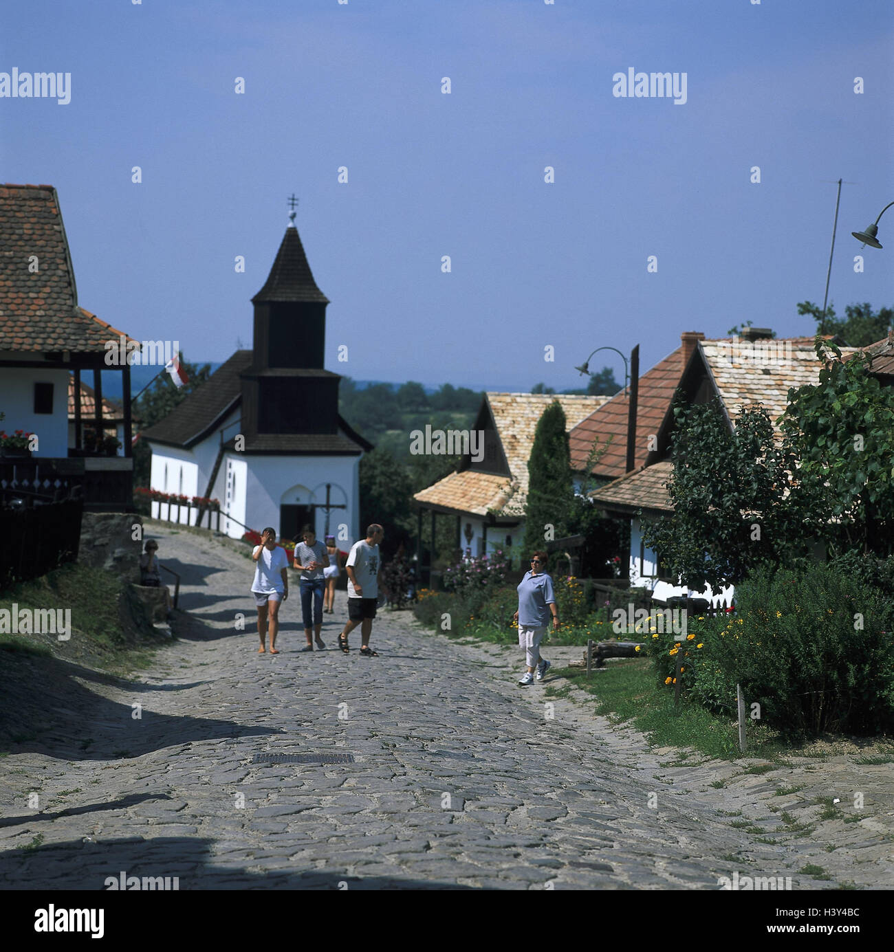 Hungary, Holloko, local view, church, lane, pedestrian, Hollokö, raven stone, local view, parish church, wooden - Stock Image
