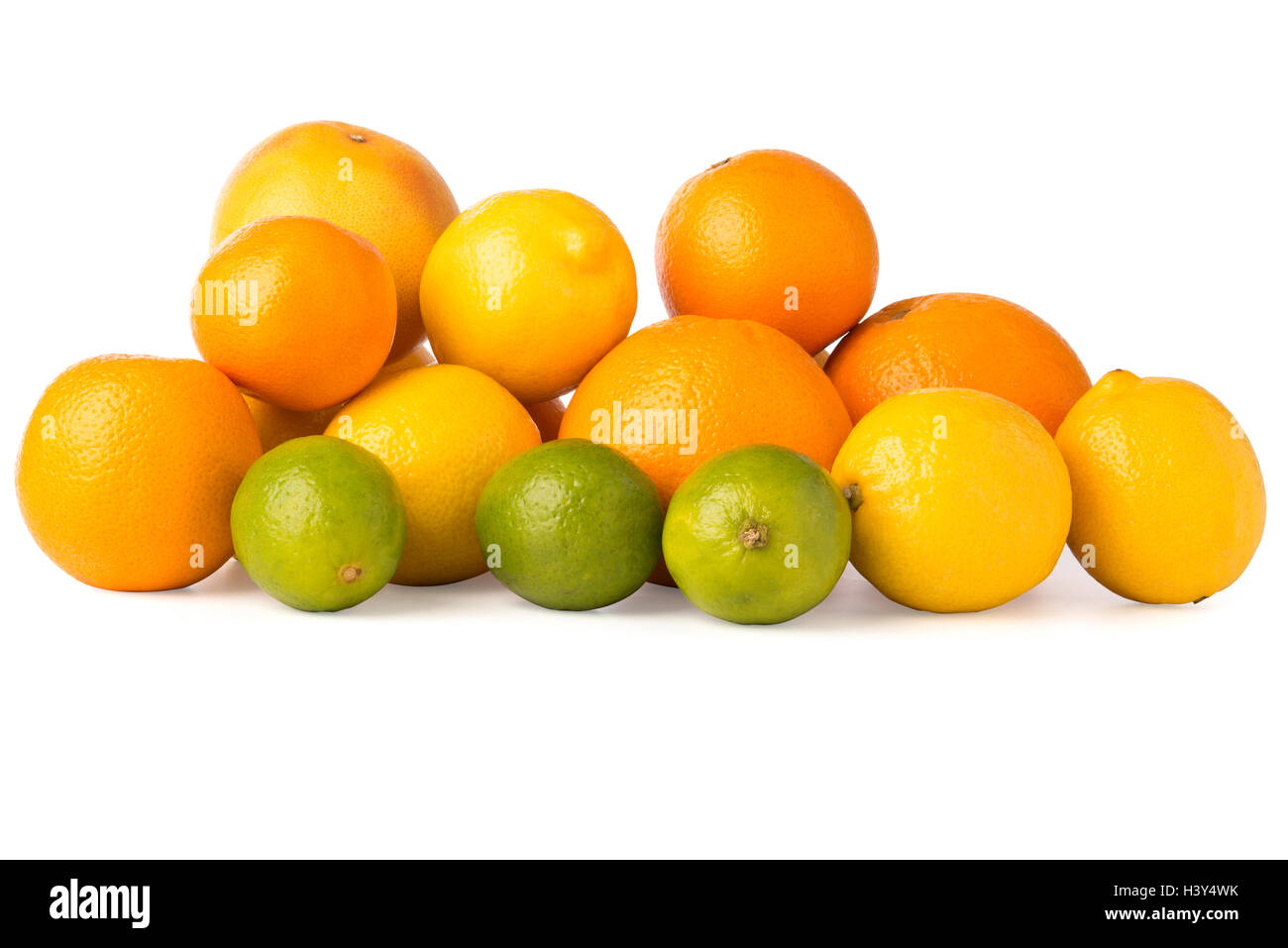 Cutout of a collection of citrus fruits including oranges, grapefruit, lemons, and lime. - Stock Image