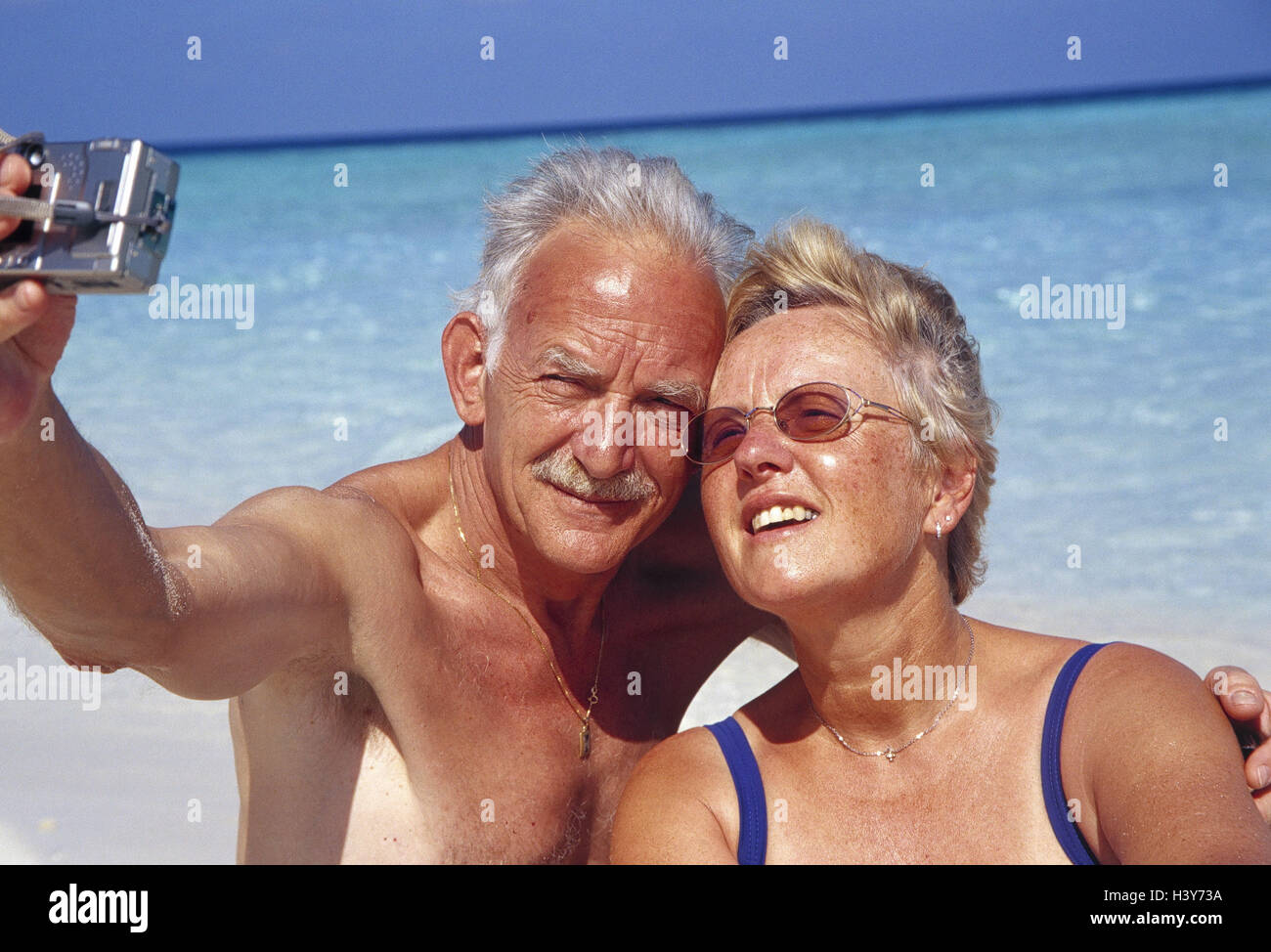 Beach, Senior couple, swimwear, camera, selfportrait vacation, leisure time, retirement, old age pension, pension, - Stock Image