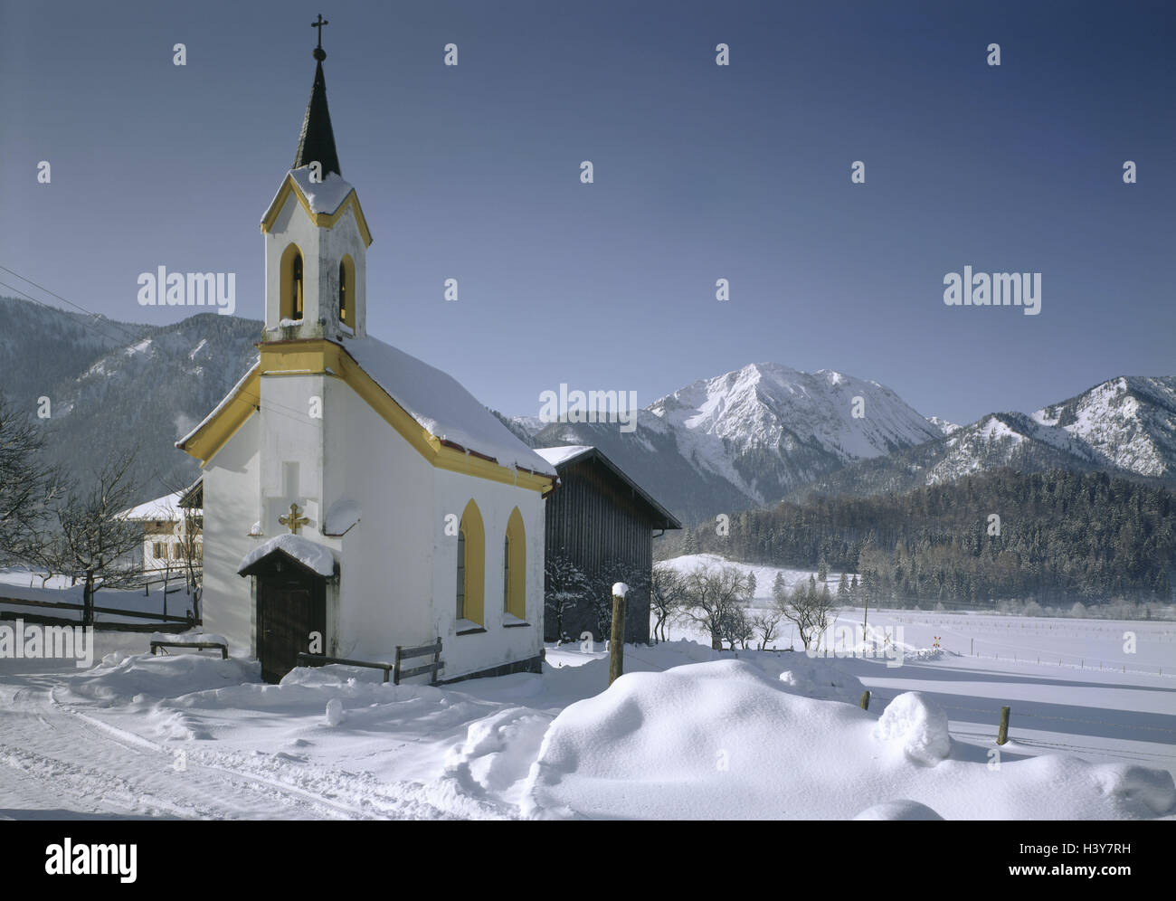 Germany, Upper Bavaria, Bayrischzell, band, winter, Europe, Bavaria, mountain landscape, snow, church, faith, religion, - Stock Image