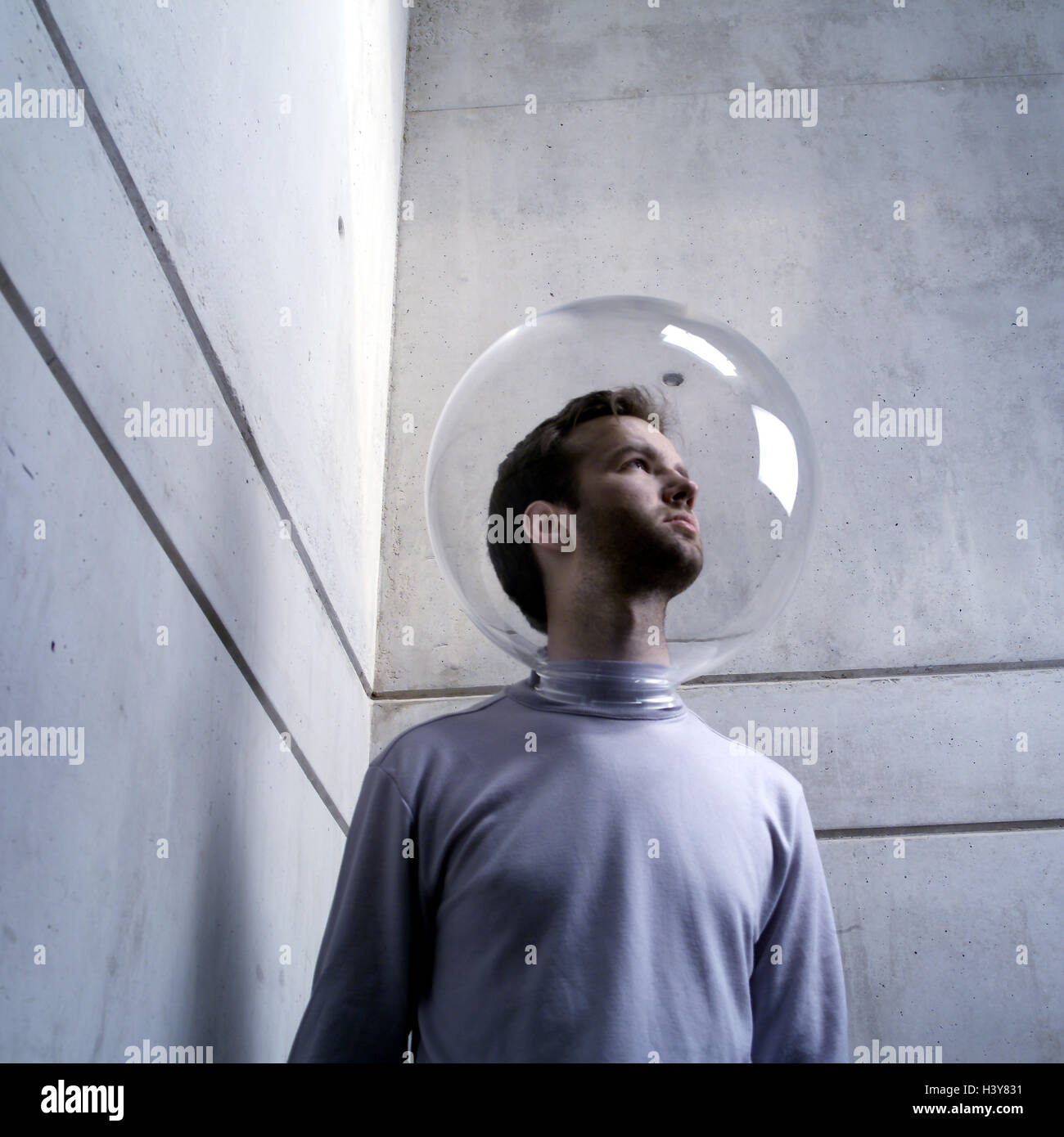 Man, head, glass ball, protection, isolation, defense, allergy - Stock Image