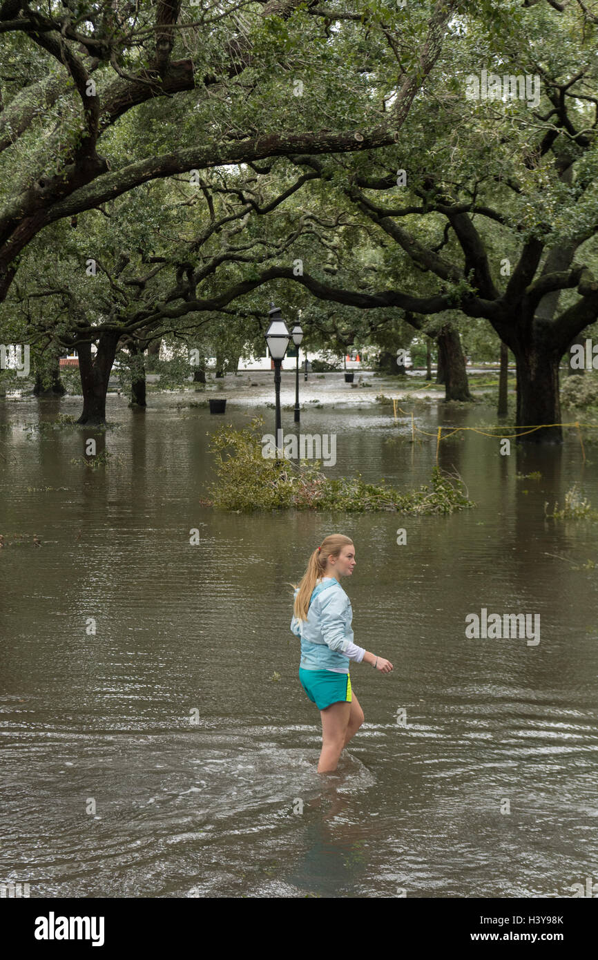 A young girl walks through flood water in White Point Garden in ...
