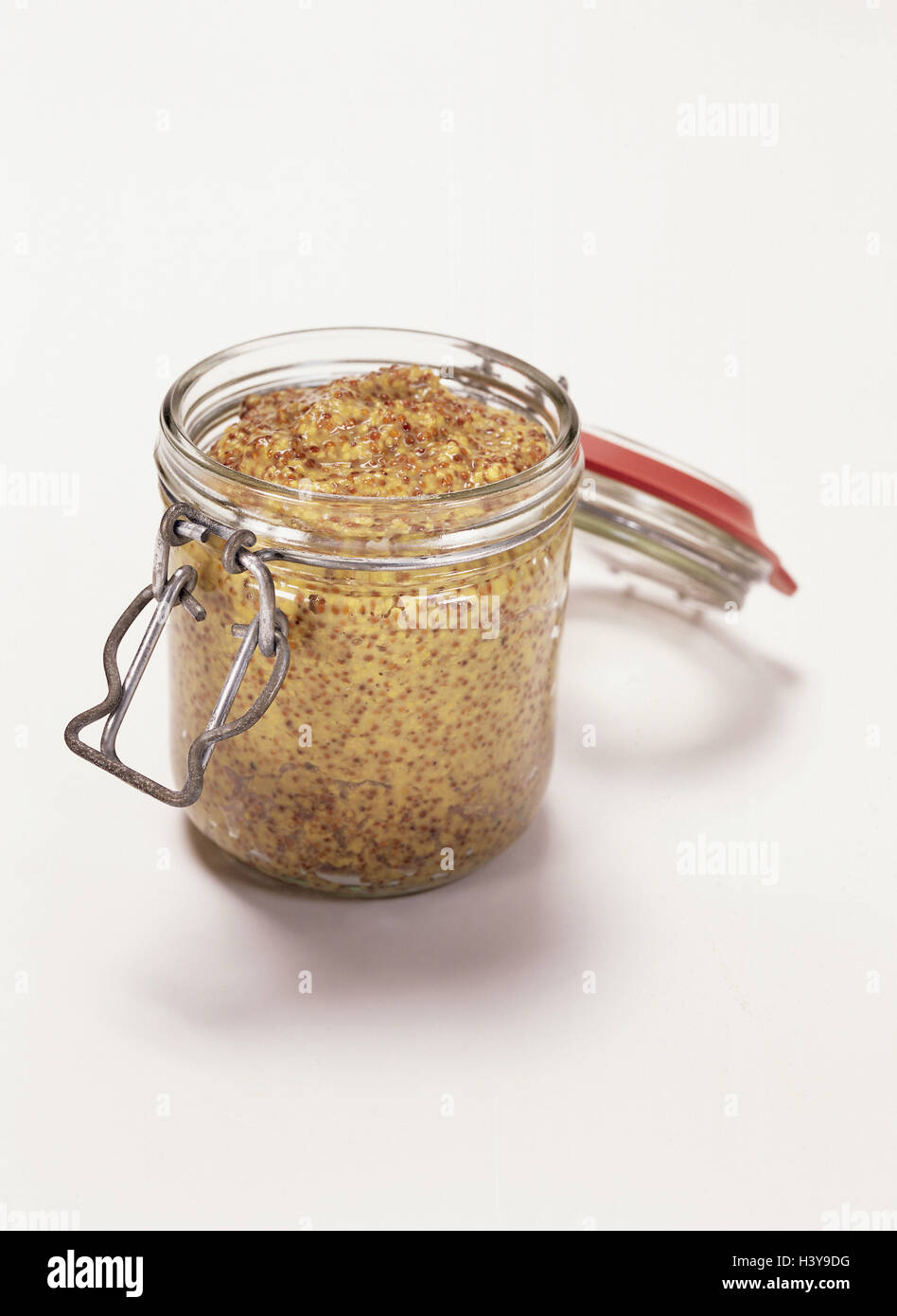 Preserving jar, mustard, coarse grained mustard glass, preserving jar, glass, stock glass, mustard seed, spice, - Stock Image