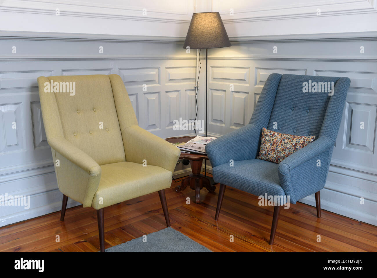 Two Armchairs And A Floor Lamp On A Reading Corner