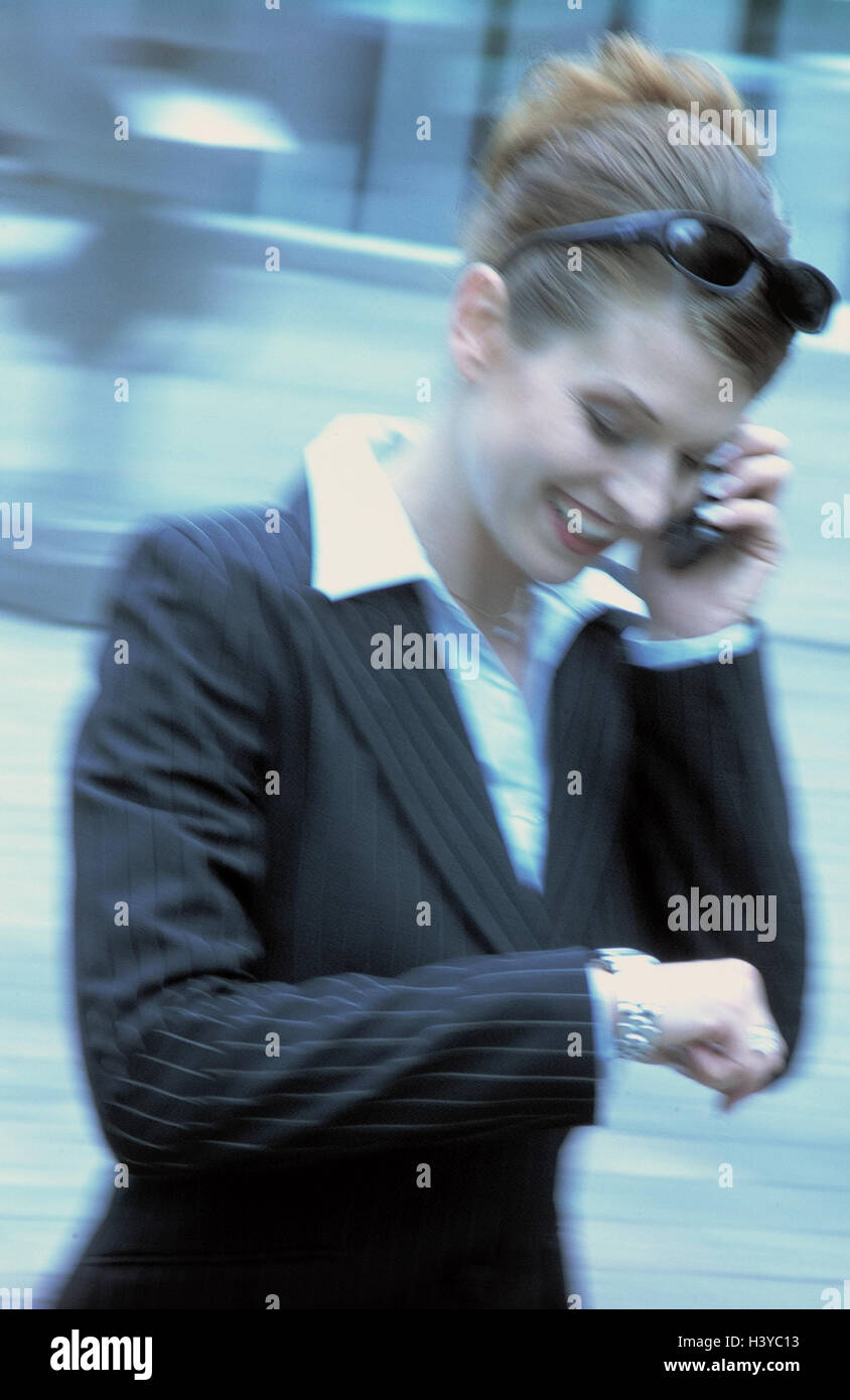 Businesswoman, mobile phone, telephone call, view, wristwatch, half portrait, outside, town, woman, manager, young, - Stock Image
