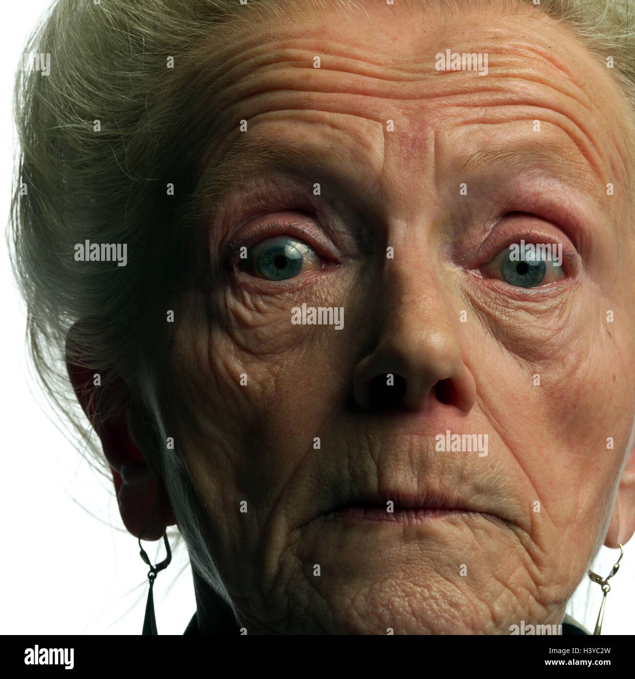 Senior, facial play, fright, surprise, portrait, very close, old person, pensioner, woman, old, shell, creased, - Stock Image