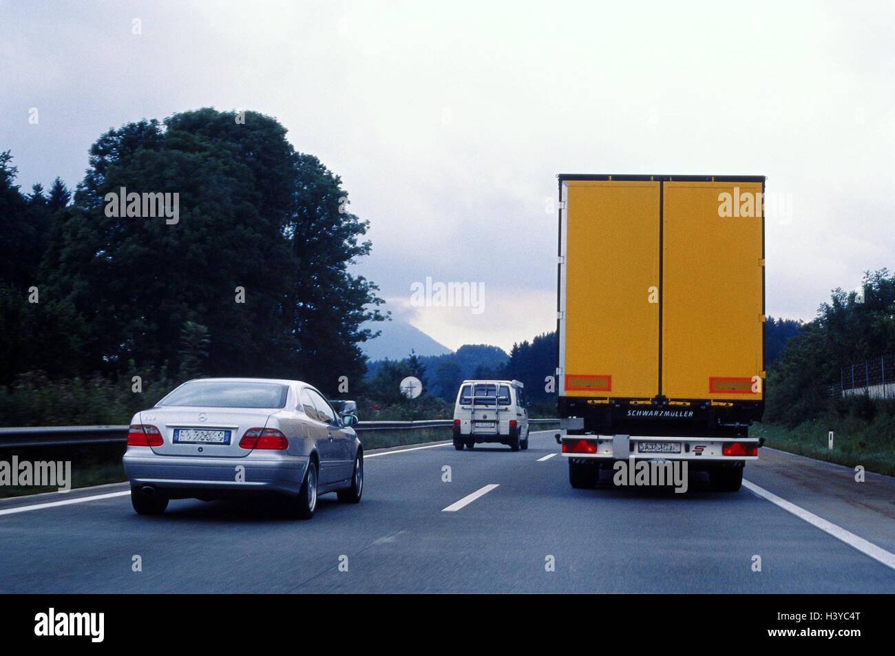 Highway, traffic, cars, trucks overtaking manoeuvre, rear view! CAR REGISTRATION NUMBERS UNRECOGNIZABLE MAKE! Street, - Stock Image
