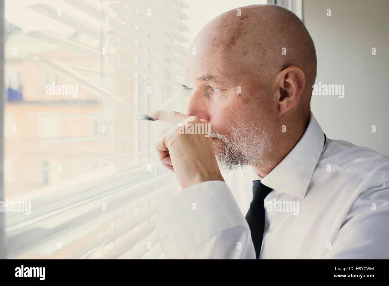 Man Peering Out Window Stock Photos Man Peering Out Window Stock