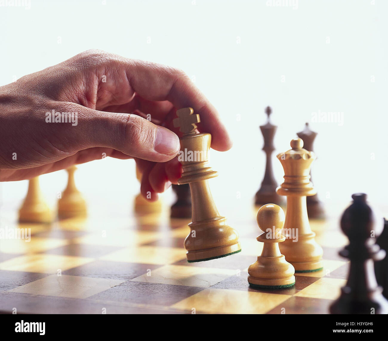 Man's hand, chess game, chess, hand, manoeuvre, figure, chess piece, king, chess pieces, chess springboard, - Stock Image