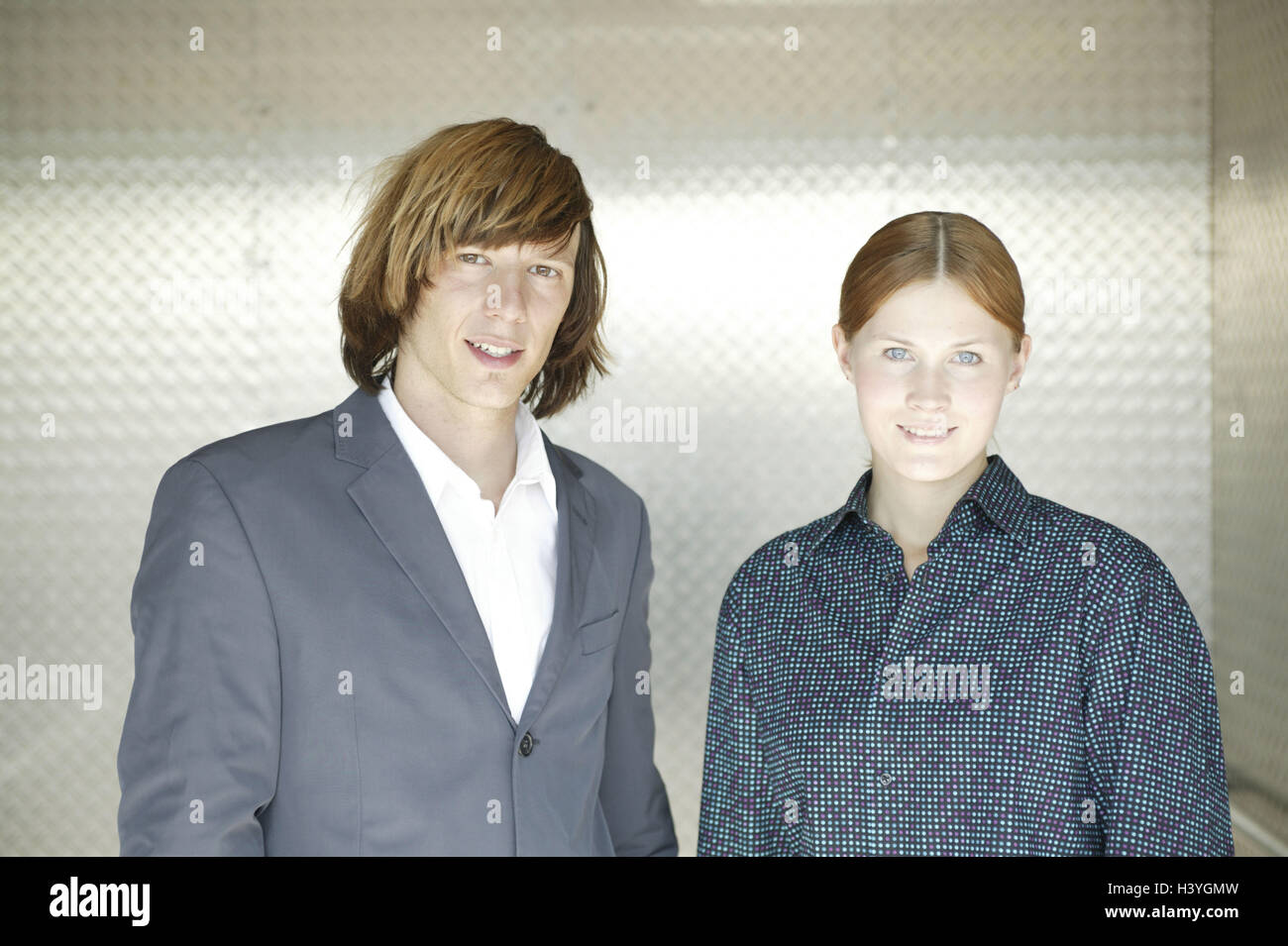 Couple, young, smile, half portrait, 15 - 20 years, woman, young, blouse, man, 20-30 years, sports jacket, suit, - Stock Image