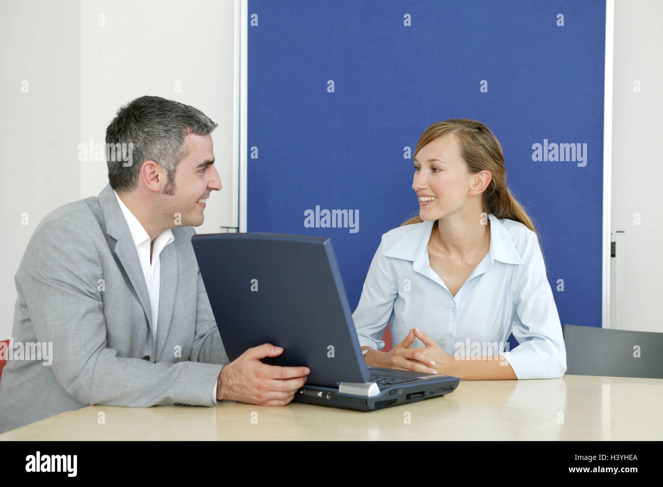 Businessman, notebook computer, woman, young, consultation, smile, present business, conference room, man, manager, - Stock Image