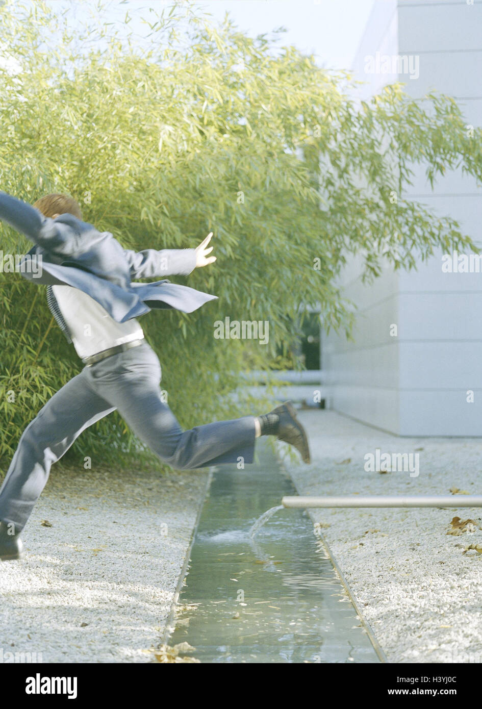 Buildings, brook, businessman, crack, man, suit, manager, waters, water, jump, overcome motion, rivlet, icon, conception, Stock Photo