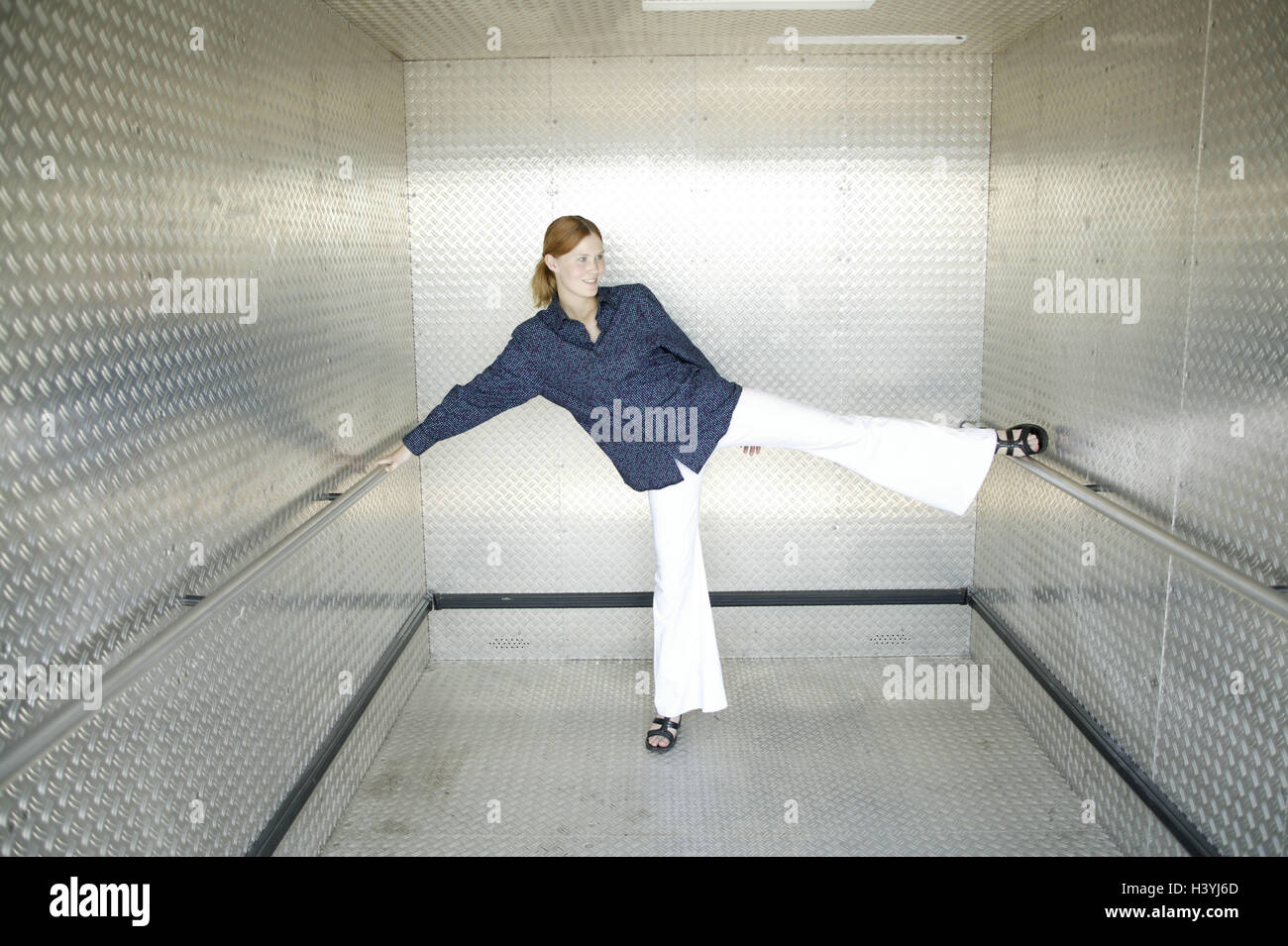 Lift, woman, young, motion, stretch, 15 stick - 20 years, young persons, trainees, trainee, lift, lift, handrail, - Stock Image