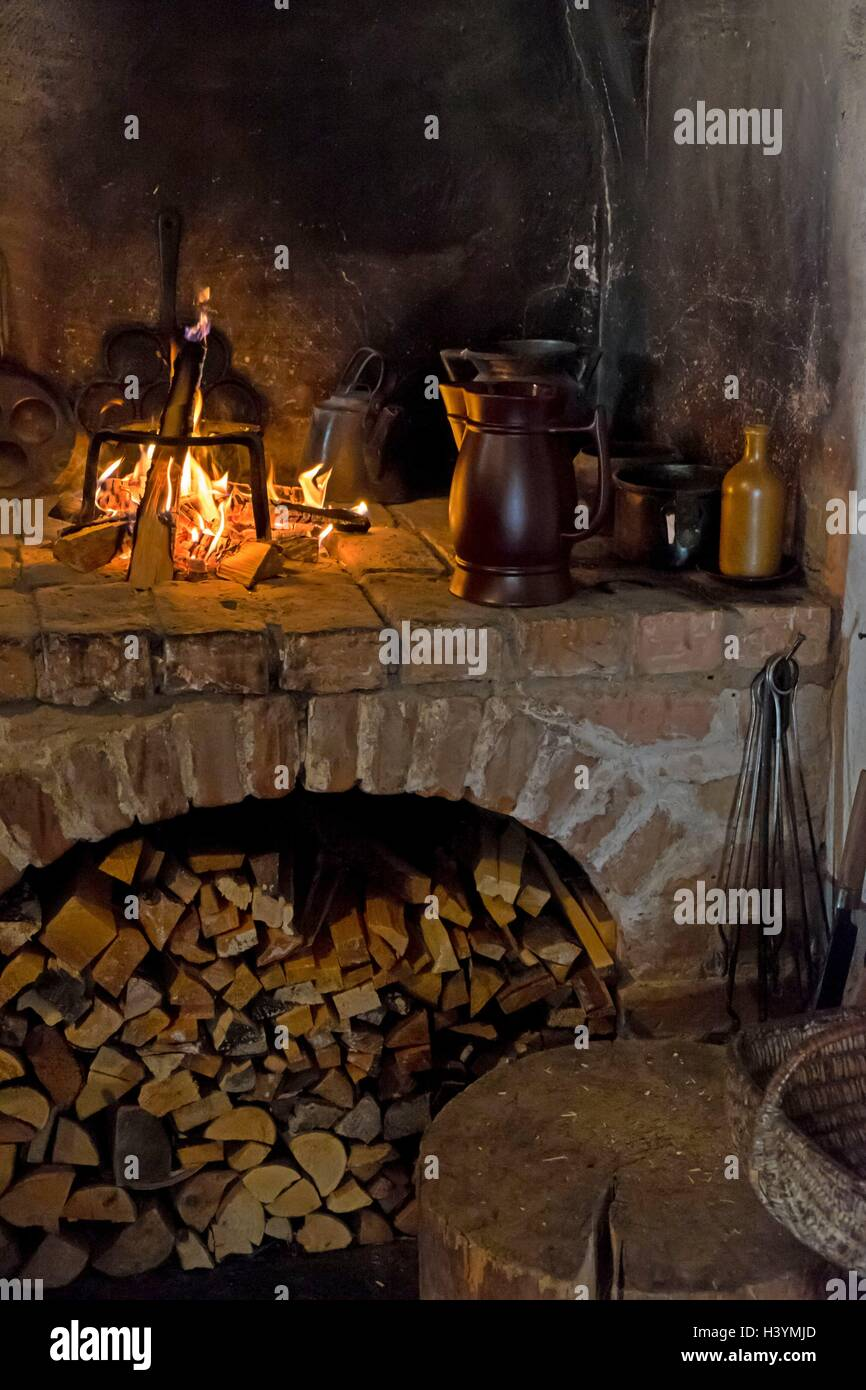 An old open fire place in the house with chimney - Stock Image