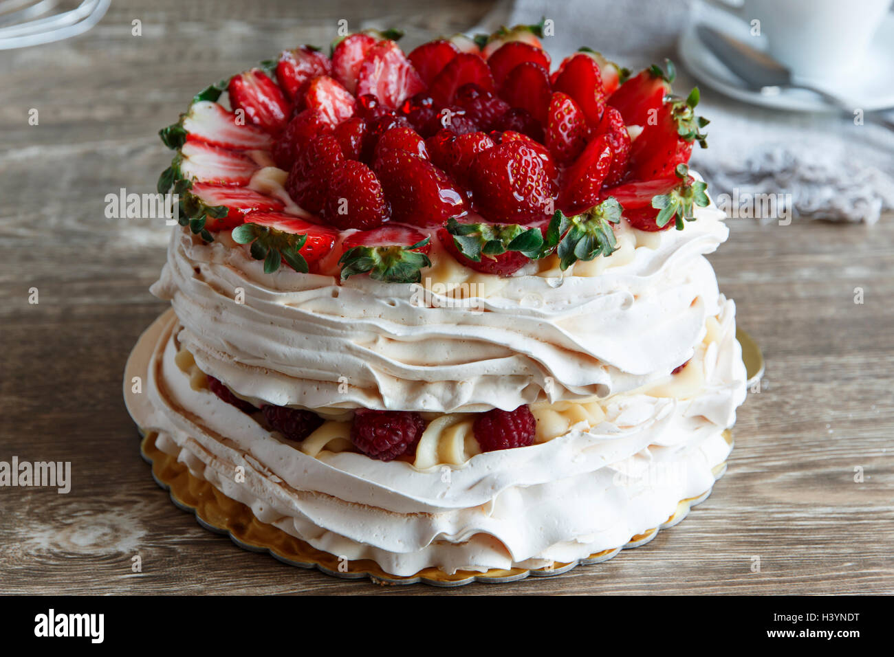 meringue cake with custard and strawberry raspberry - Stock Image