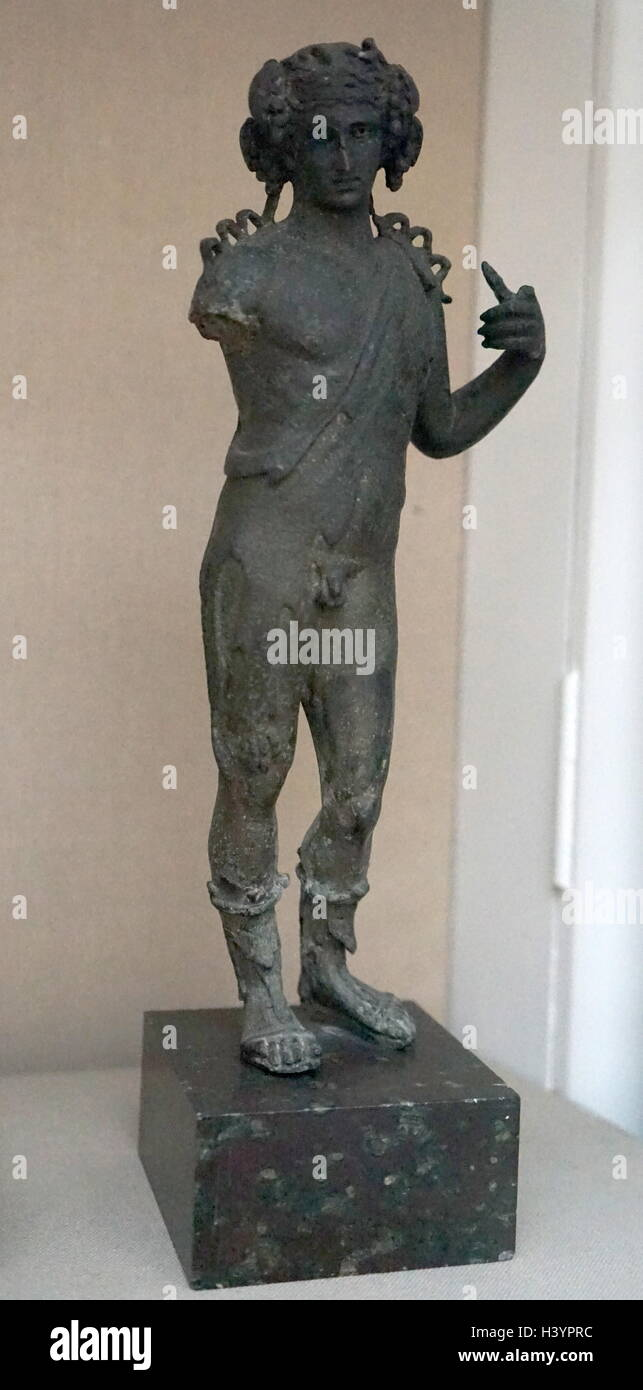 Greek 2nd century BC, statuette in bronze; depicting the god of wine, Dionysus. Ionian Islands, Greece - Stock Image