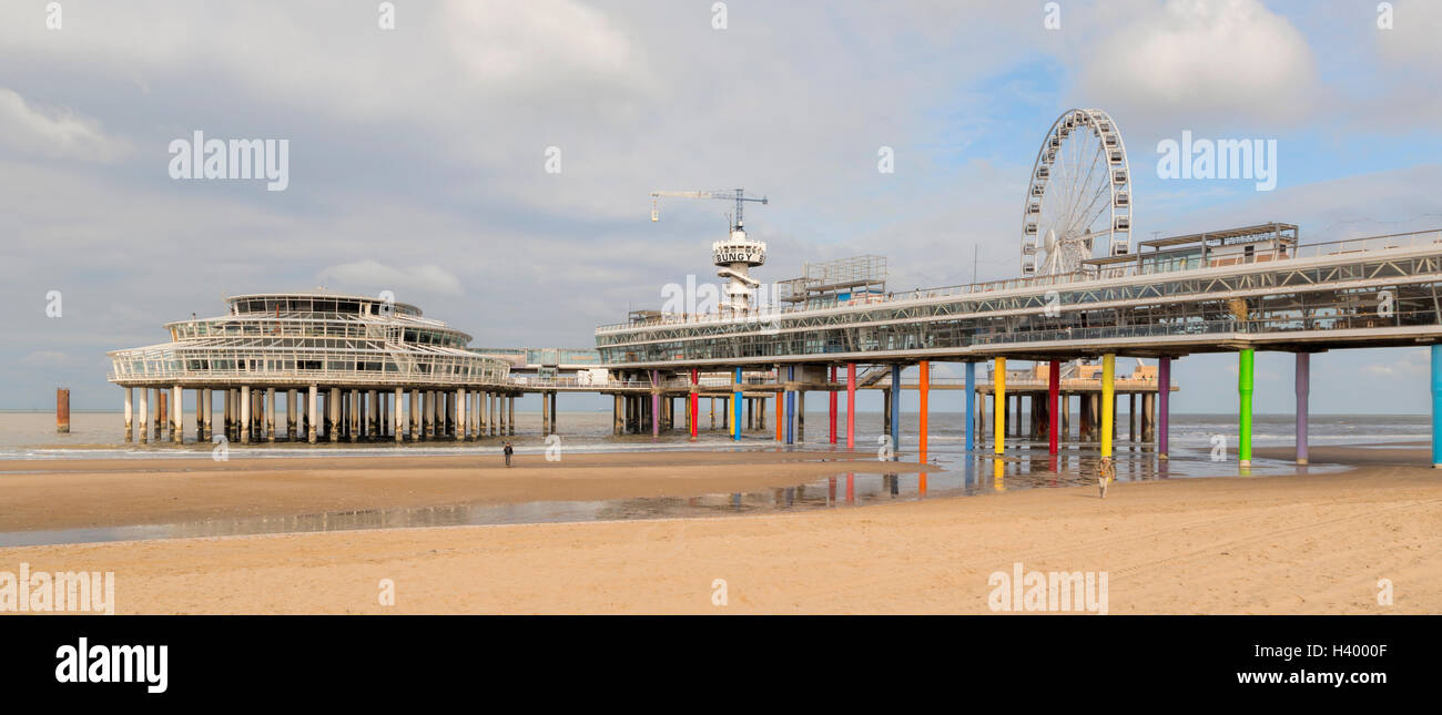 Wide angle view on Scheveningen Pier, a bungy-jumping tower and a ferris wheel, The Hague, South Holland, The Netherlands. Stock Photo