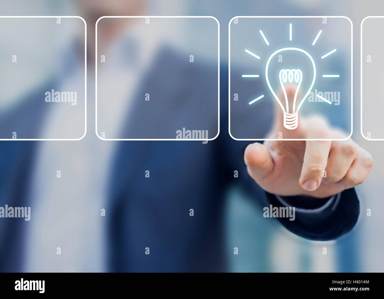 Business idea concept with lightbulb symbol touched by businessman and office background - Stock Image