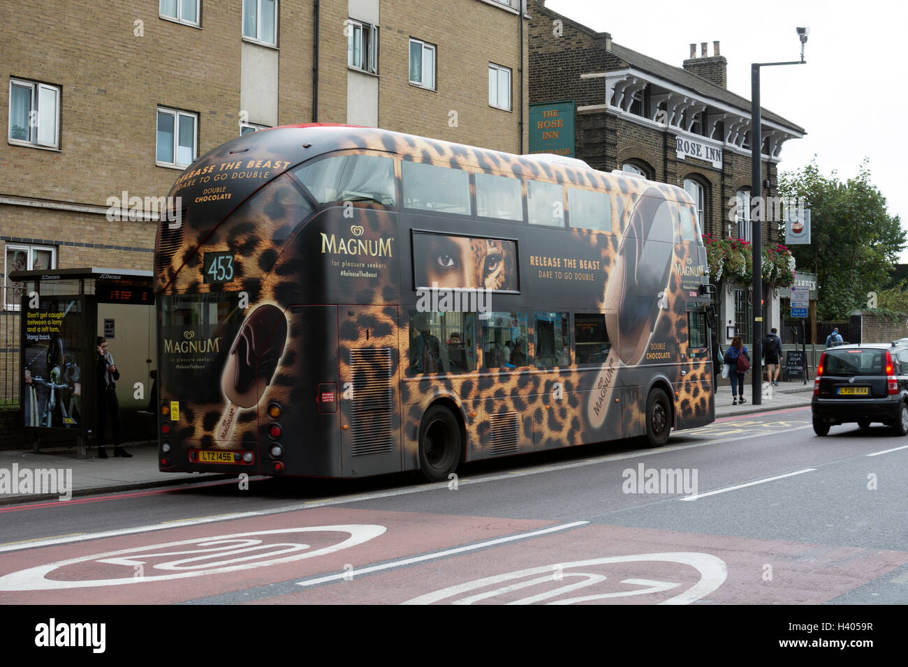 Routemaster bus with Magnum ice cream livery, New Cross Road, London, UK - Stock Image