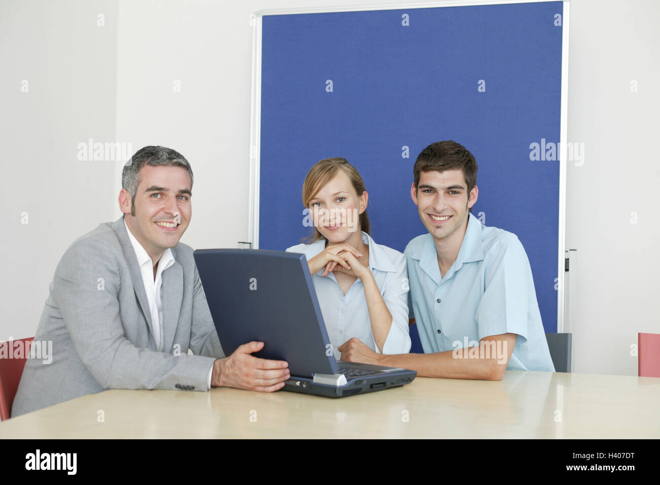 Businessman notebook computer couple young consultation smile present business conference room man manager 30-40 - Stock Image