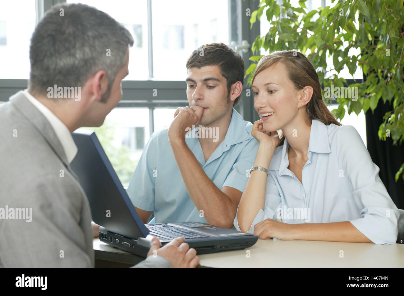 Businessman notebook computer couple young consultation business office man manager banker broker insurance broker - Stock Image