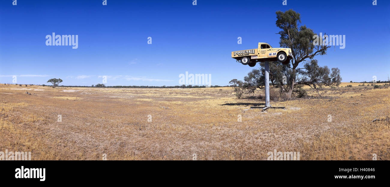 Australia, New South Wales, out cheek, rolled steal joist, pickup truck, advertisement, tip, garage, steppe scenery, - Stock Image