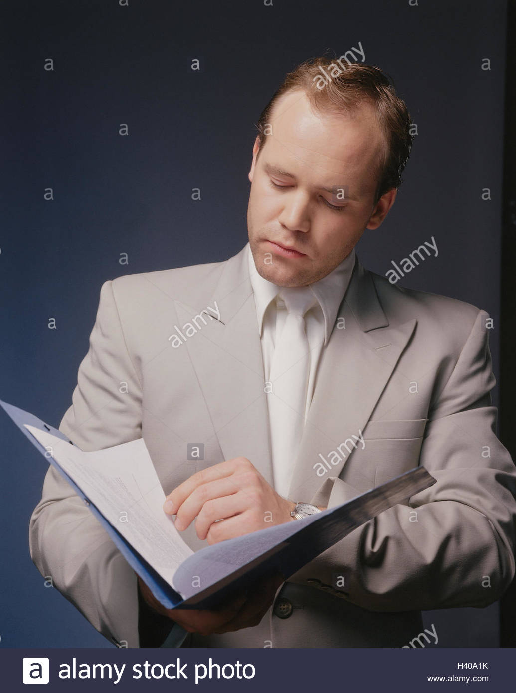 Businessman, bases, read, portrait, man's portrait, 20-30 years, Manager, suit, tie, business papers, papers, - Stock Image