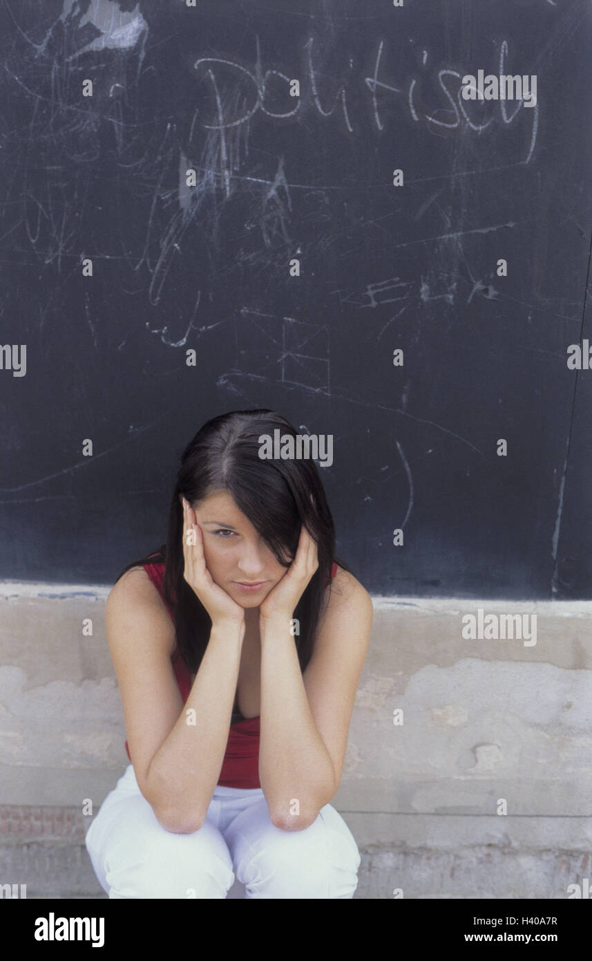 blackboard, label, politically, young persons, sit, keep closed ears woman, young, 17 years, youth, setting, disinterest, - Stock Image