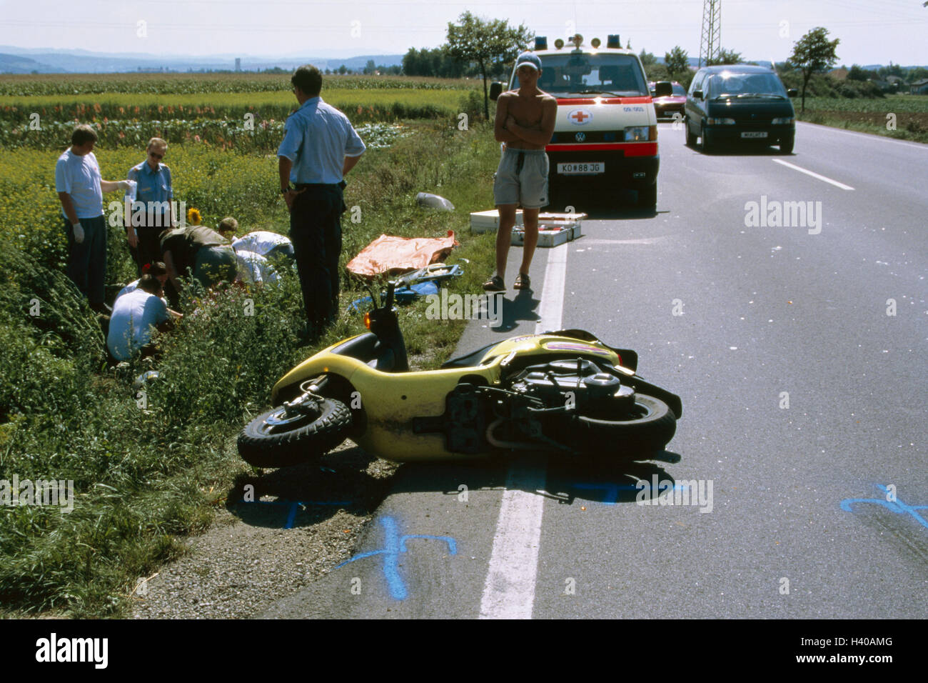 Traffic accident, roadside ditch, injured person, emergency doctor ...
