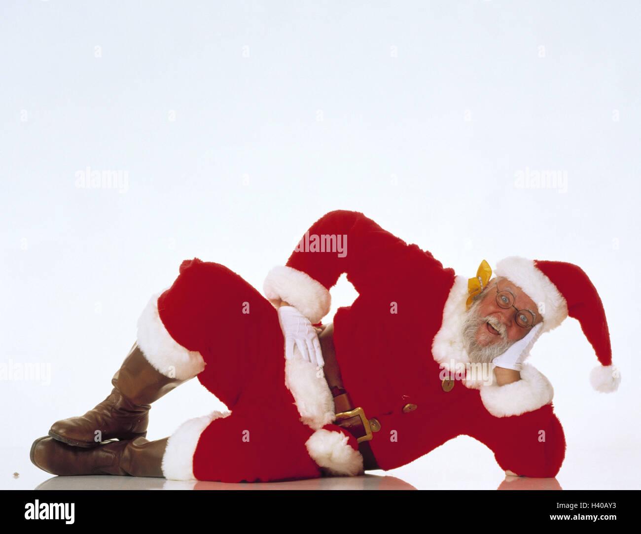 Santa Claus, lie, head, X-mas, Christmas, Santa, recreation, rest rest on, take it easy, inside, studio, cut out, - Stock Image