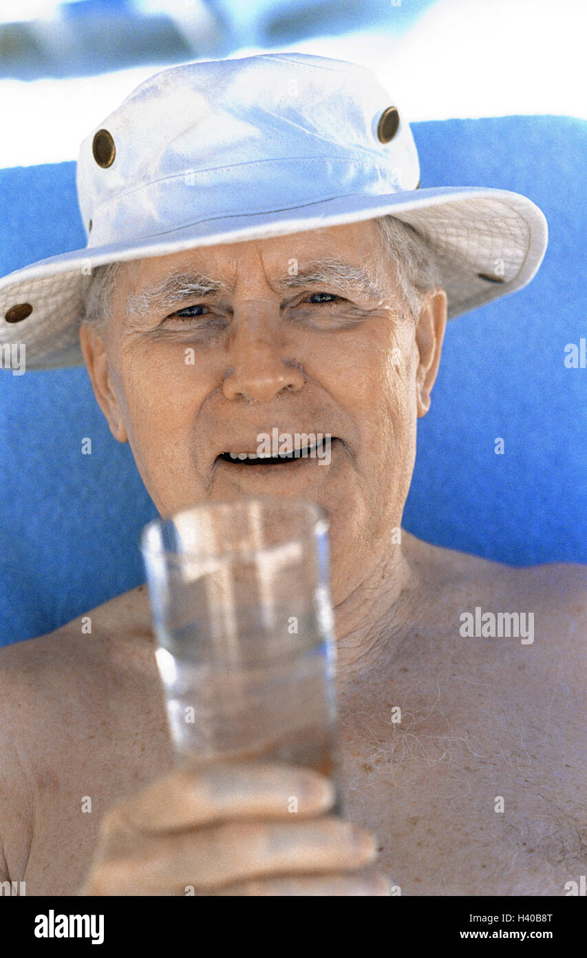 Senior, free upper part of the body, care, water glass, happy, lighthearted, portrait, senior citizens, pensioners, - Stock Image