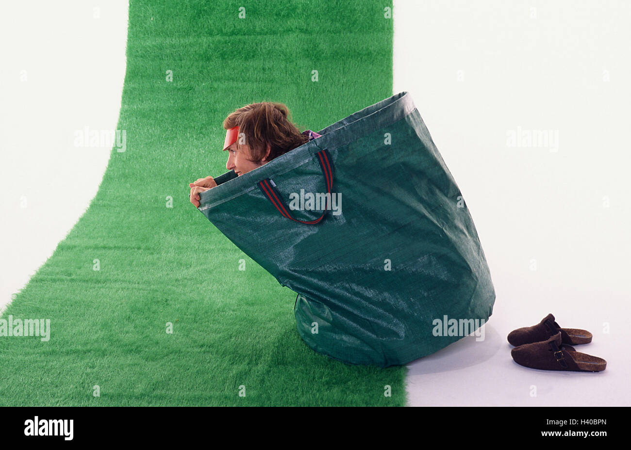 Man, sit young, foliage pouch, art turfs, 20-30 years, fun, fun, funnily, cheerfulness, pouch, case, green, icon, - Stock Image