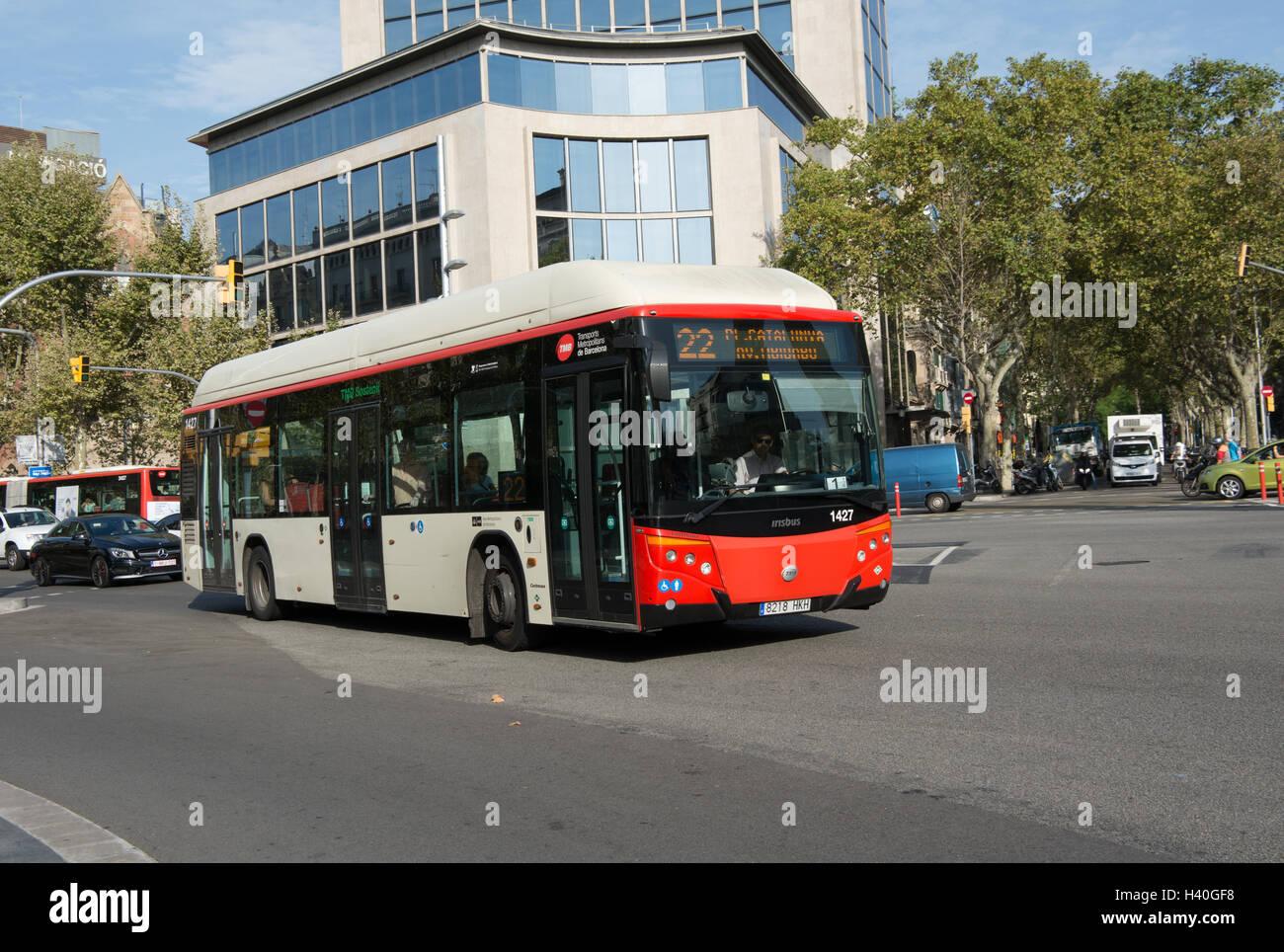 An Irisbus Citelis 12 GNC fitted with Castrosua CS.40 Versus bodywork travels along Avinguda Diagonal Barcelona. - Stock Image