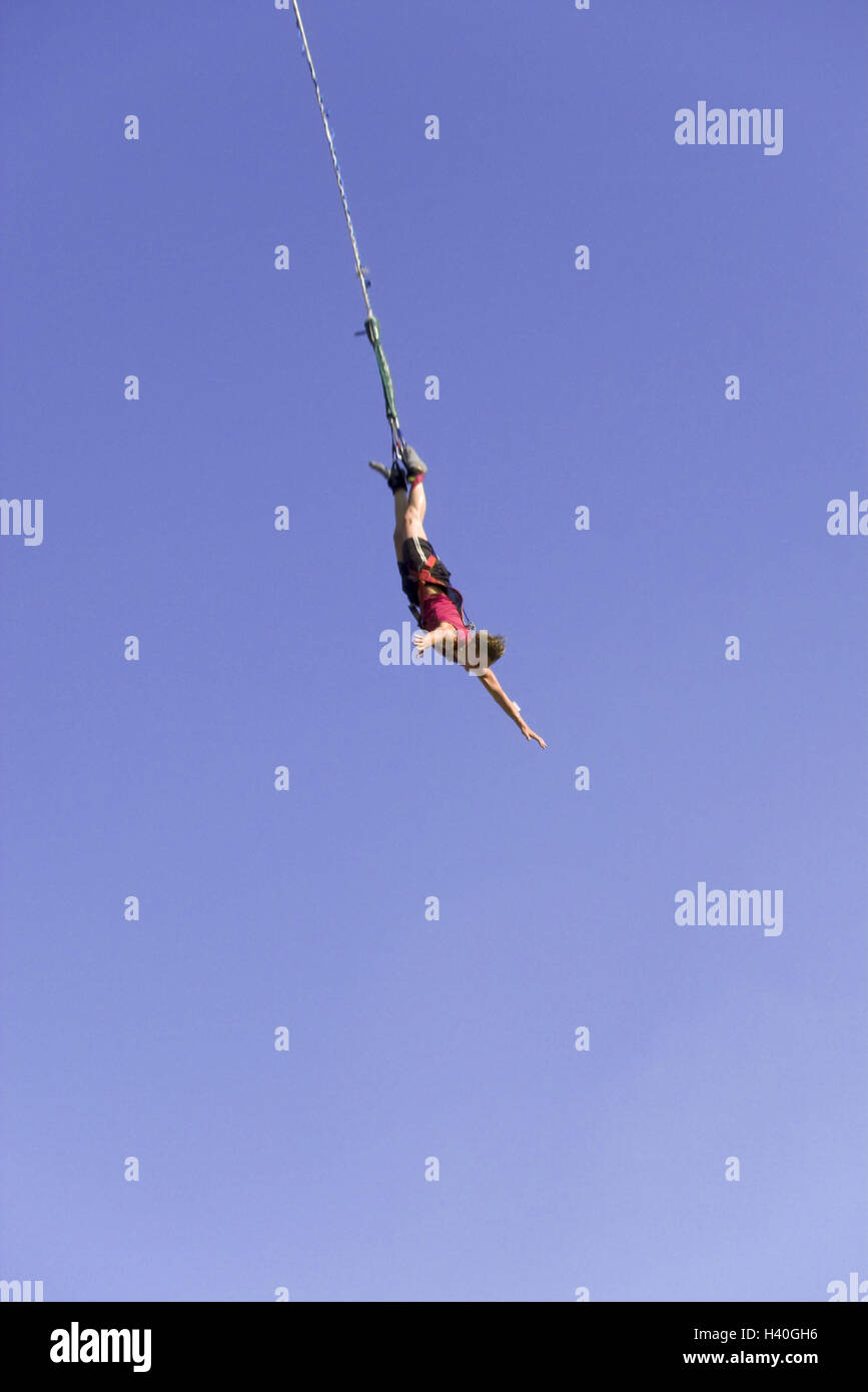 Bungeejumping, man, person, arms spread, jump, fall, heavens, blue, cloudless, height, air, rope, hang, side view, Stock Photo