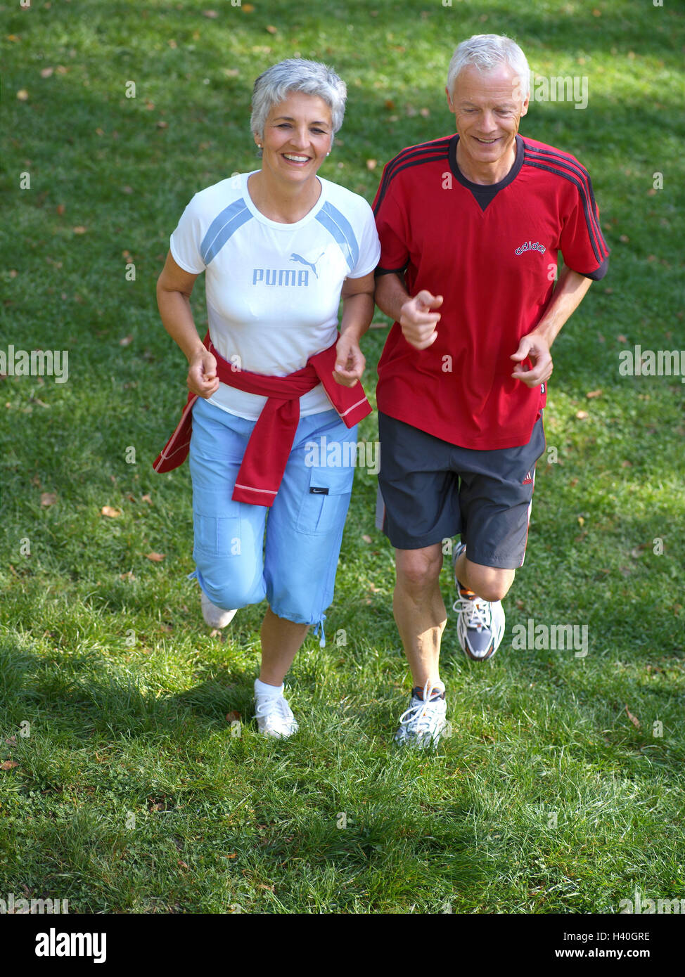 meadow senior couple jog run happy from above 50 60 years stock