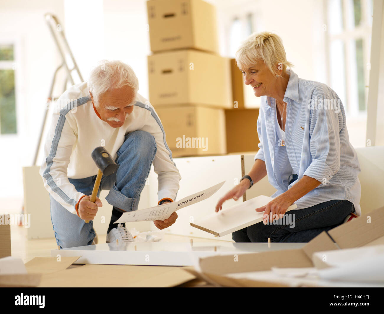 Procession, Senior couple, St. furniture, assemble, concentration, 60-70 years, senior citizens, couple, flat change, - Stock Image