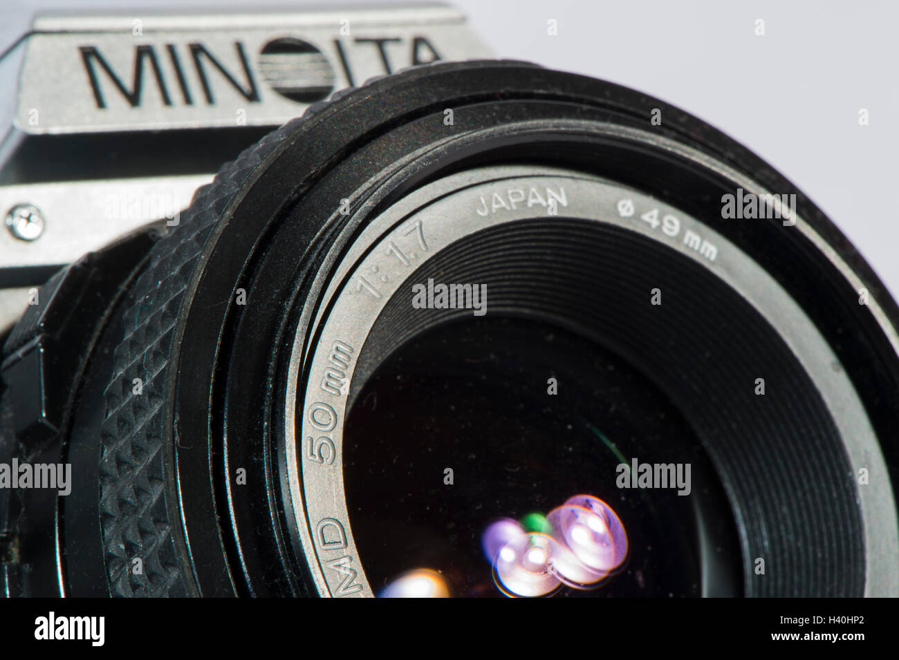 Detail of classic 1980's Minolta X-300 - 35mm film, SLR camera with a 50mm Minolta prime lens, seen against - Stock Image